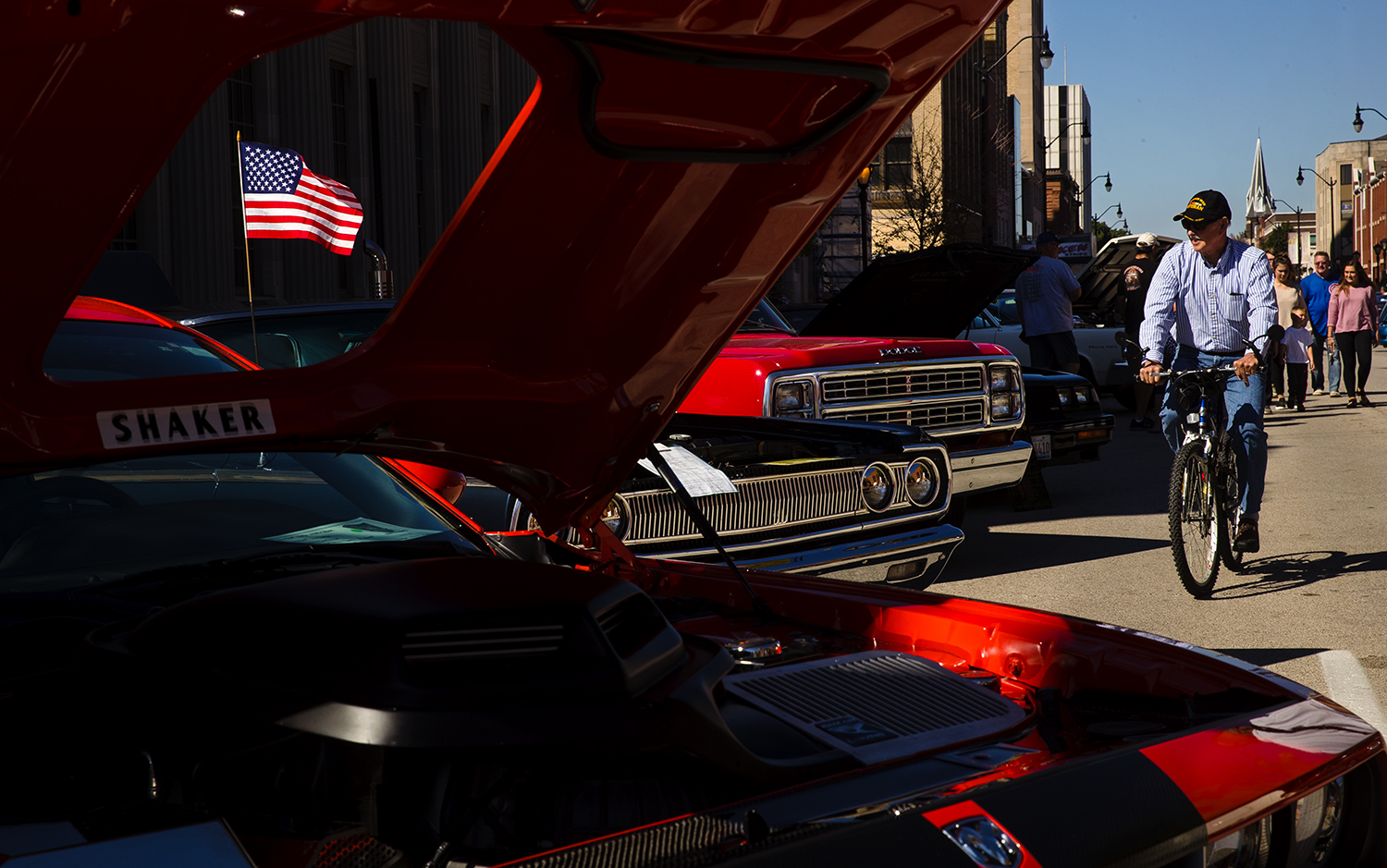 Guests view the vintage and modern vehicles on display during the 17th Annual International Route 66 Mother Road Festival Sunday, Sept. 23, 2018. [Ted Schurter/The State Journal-Register]