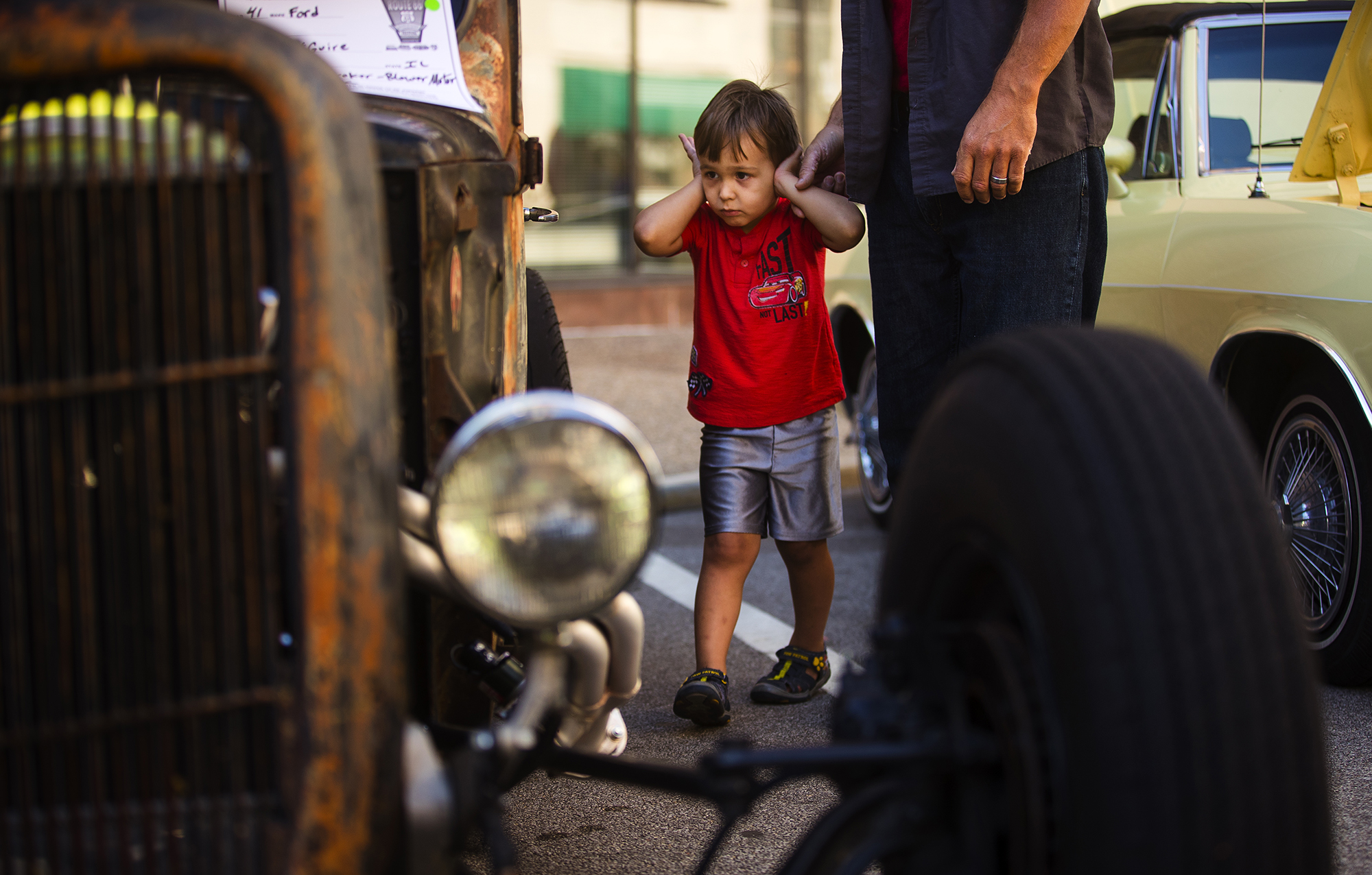 Carter Haseley covers his ears as a loud engine revs nearby while he takes in the 17th Annual International Route 66 Mother Road Festival with his dad John Sunday, Sept. 23, 2018. [Ted Schurter/The State Journal-Register]
