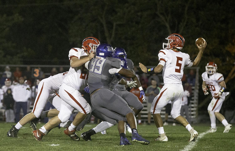 Glenwood's Luke Lehnen stays in the pocket under pressre before making a deep touchdown throw at Decatur MacArthur High School Friday, Sept. 28, 2018. [Ted Schurter/The State Journal-Register]
