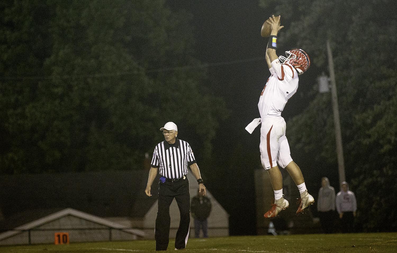 Glenwood's Luke Lehnen leaps to catch a high snap at Decatur MacArthur High School Friday, Sept. 28, 2018. [Ted Schurter/The State Journal-Register]