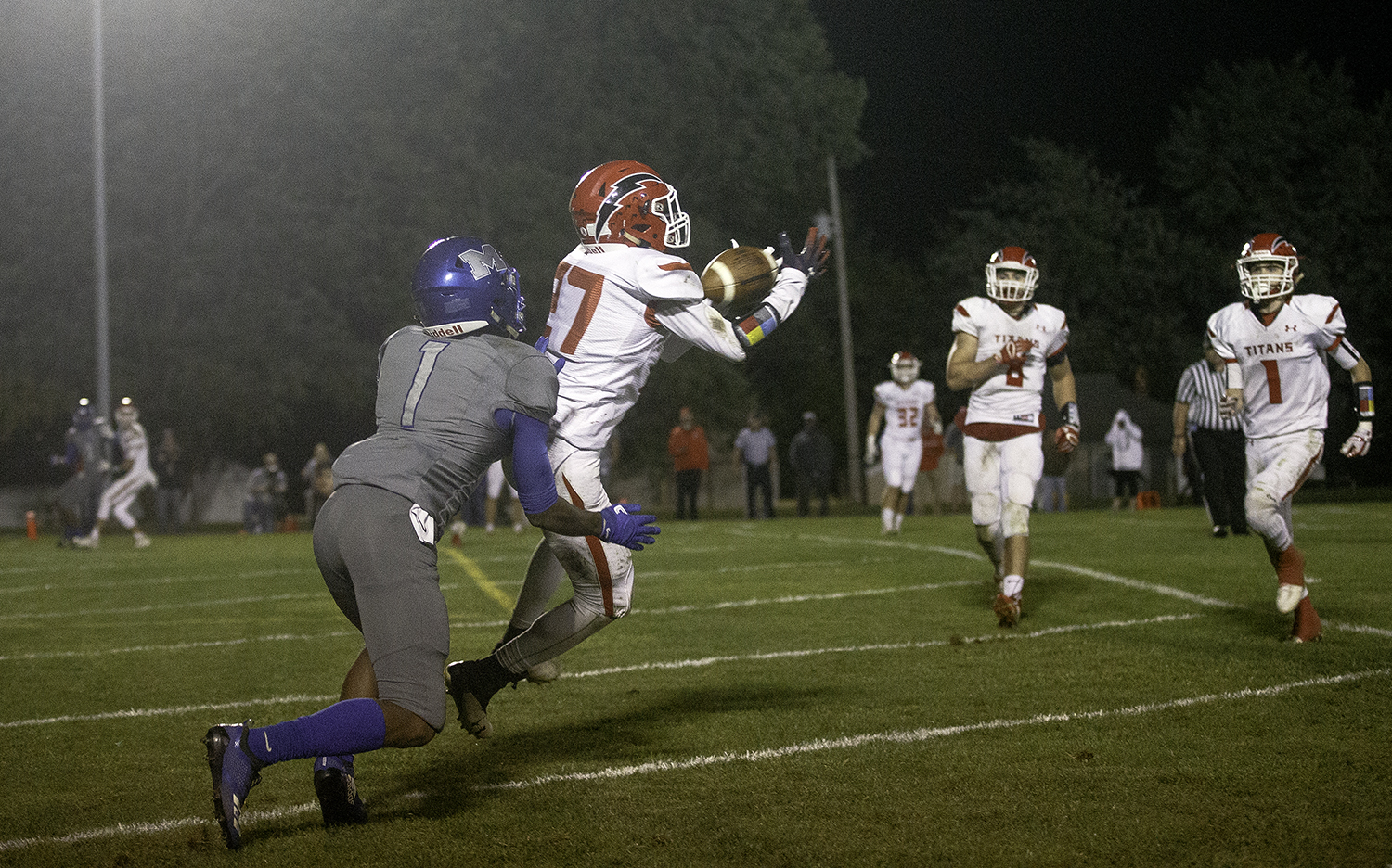 Glenwood's Austin Bush picks off a two point conversion pass in front of Decatur MacArthur's AJ Lawson at Decatur MacArthur High School Friday, Sept. 28, 2018. [Ted Schurter/The State Journal-Register]