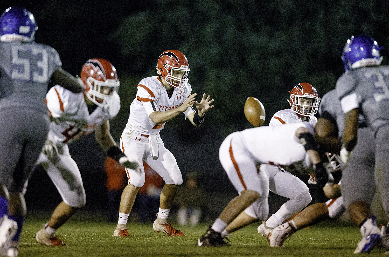 Glenwood's Luke Lehnen takes a snap against Decatur MacArthur at Decatur MacArthur High School Friday, Sept. 28, 2018. [Ted Schurter/The State Journal-Register]