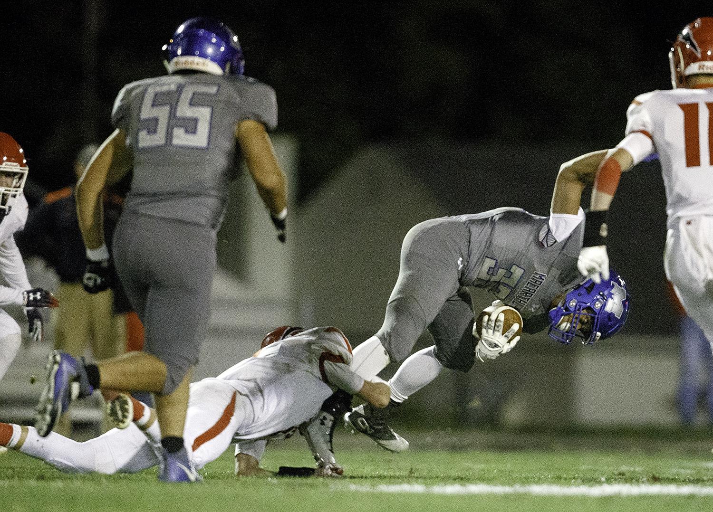 Decatur MacArthur's Derrick Taylor slips away from a Glenwood defender before scoring a touchdown at Decatur MacArthur High School Friday, Sept. 28, 2018. [Ted Schurter/The State Journal-Register]