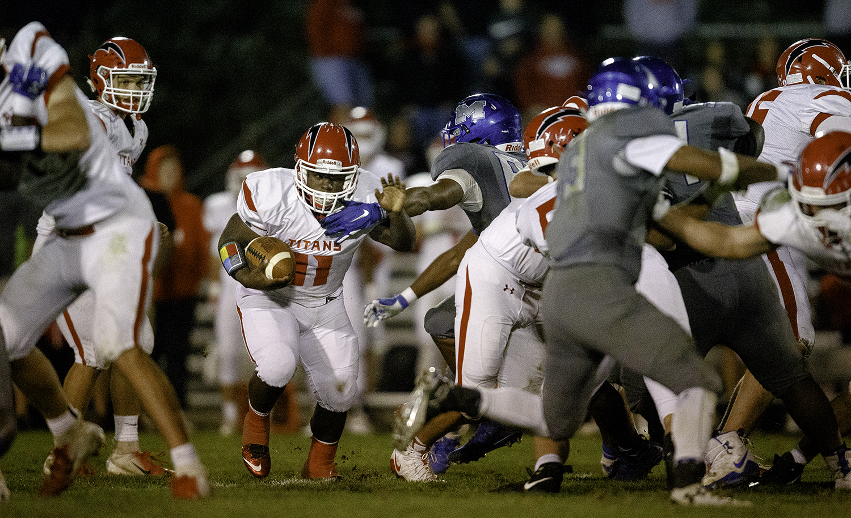 Glenwood's Tyler Estes rushes against Decatur MacArthur at Decatur MacArthur High School Friday, Sept. 28, 2018. [Ted Schurter/The State Journal-Register]