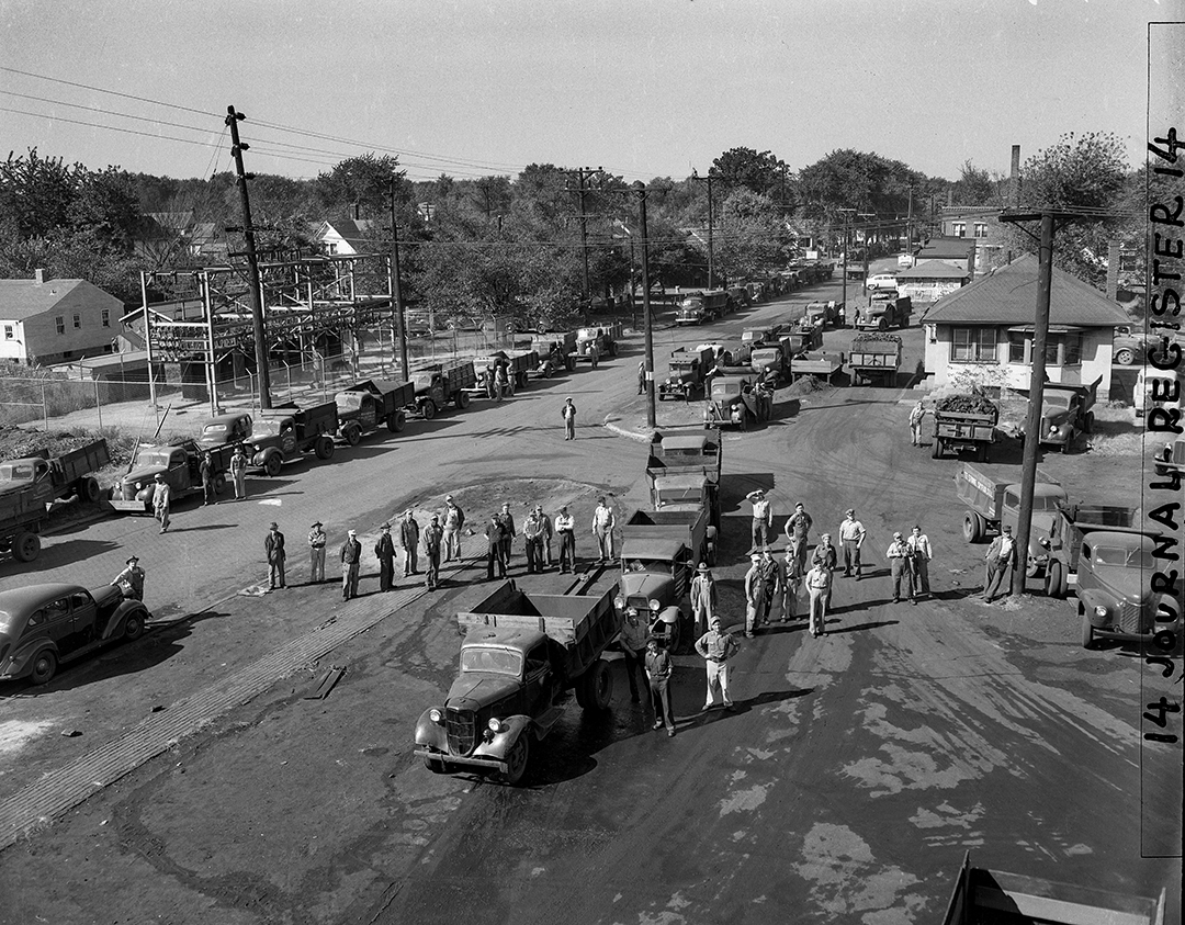 Panther Creek Mine No. 5, 11th Street and Ridgely Avenue, Springfield, Ill., Sept. 26, 1949. Pub. ISJ Sept. 27, 1949. Trucks line up waiting to load coal at the Panther Creek 5, new north mine. Lines similar to these stay in formation through the night to keep their place for the following day since John L. Lewis' United Mine Workers went on strike last week. Mine officials estimate that two or three hundred trucks are loaded daily at the mine, which is manned by members of Progressive Mine Workers of America, and are not on strike. File/The State Journal-RegisterPublished as Picturing the Past Sept. 30, 2018.A dispute over pension fund payments brought members of the United Mine Workers to a nation-wide work stoppage on September 19, 1949. The action had an immediate effect on the coal mines in Springfield that were operated by members of the Progressive Mine Workers of America, which did not strike. At the Panther Creek 5 mine at 11th Street and Ridgely Avenue, which was run by PMW miners, trucks lined up to load coal stretch into the distance down Ridgely Avenue. Some of the truck drivers would arrive late in the day and leave their trucks overnight to hold their place in line for the following morning. Mine officials told the Illinois State Journal they estimated two to three hundred trucks were loaded daily while the UMW remained on strike, which continued into early November. [File/The State Journal-Register]