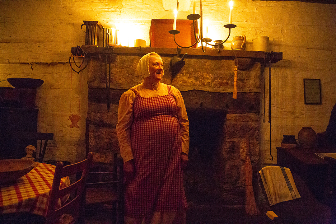 Pam Earleywine greets visitors in the Rutledge Tavern during the annual candlelight walk through Lincoln's New Salem State Historic Site [iptcdow}, Oct. 5, 2018  in Petersburg, Ill. [Rich Saal/The State Journal-Register]