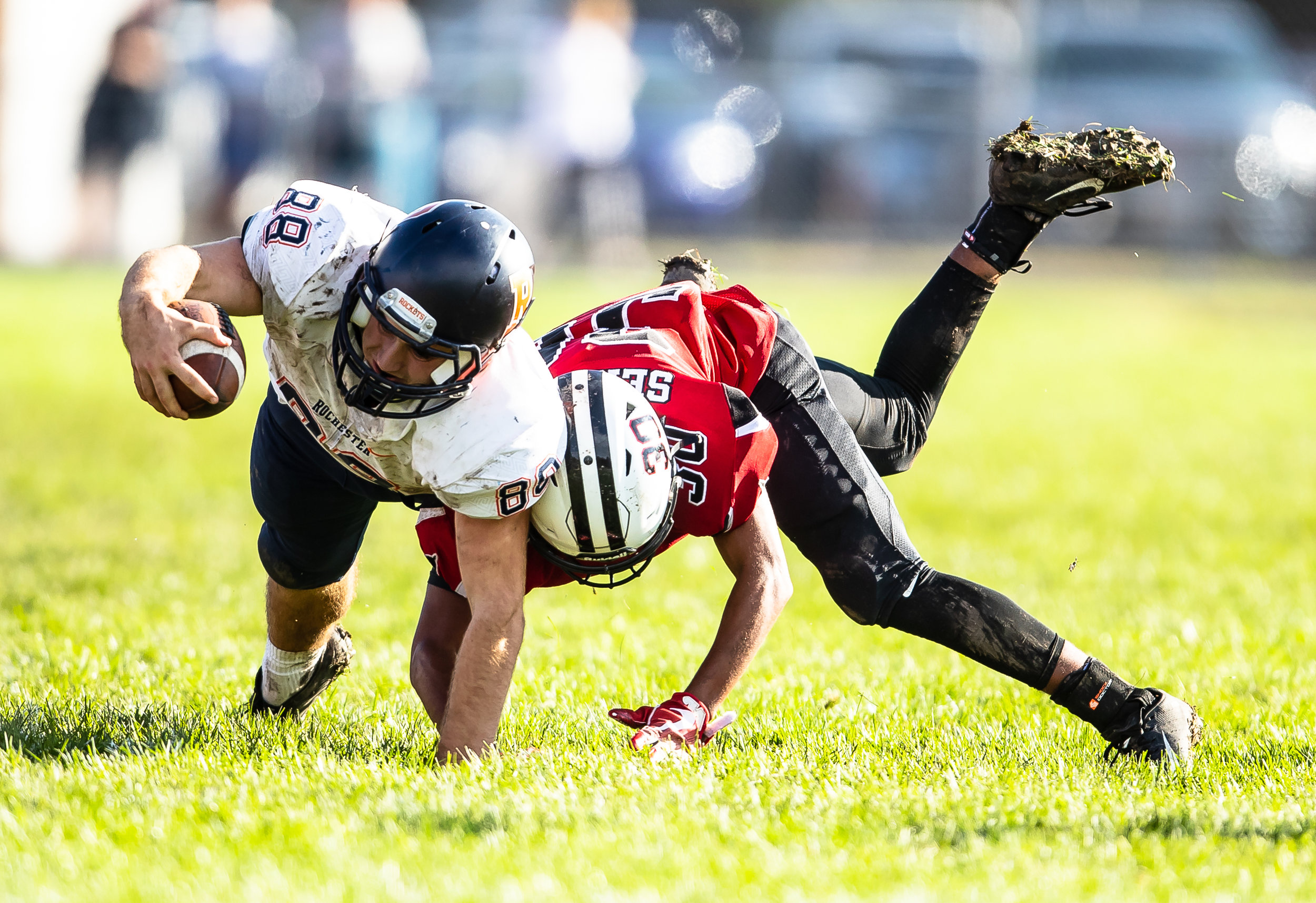 Rochester's Clay Alewelt (88) tries to stretch out for more yardage after being hit by Springfield's Qa'ron Hawkins (30) after a catch in the open field in the second half at Memorial Stadium, Saturday, Oct. 6, 2018, in Springfield, Ill. [Justin L. Fowler/The State Journal-Register]
