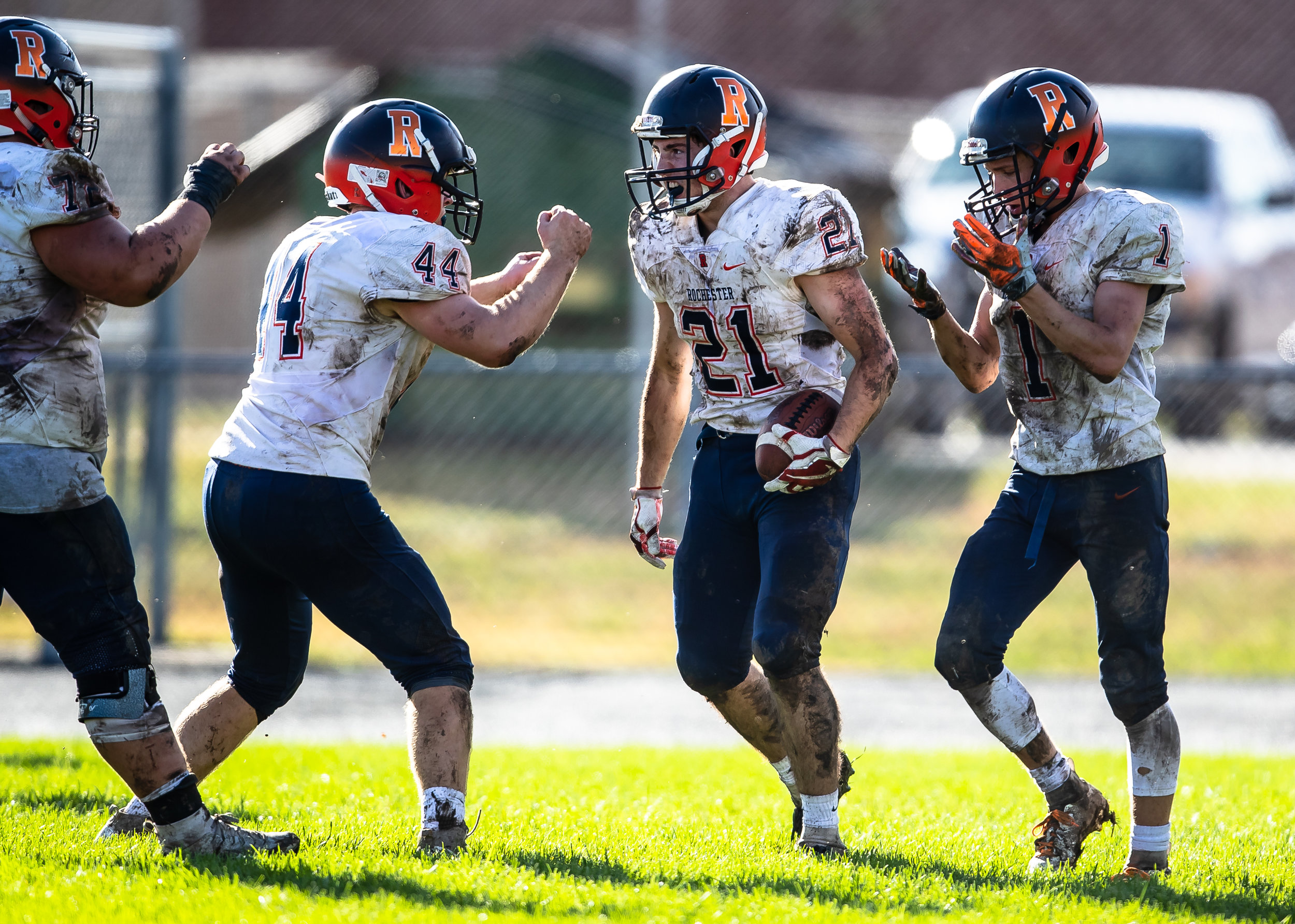 Rochester's David Yoggerst (21) is fired up with his teammates after a rushing touchdown against Springfield in the second half at Memorial Stadium, Saturday, Oct. 6, 2018, in Springfield, Ill. [Justin L. Fowler/The State Journal-Register]
