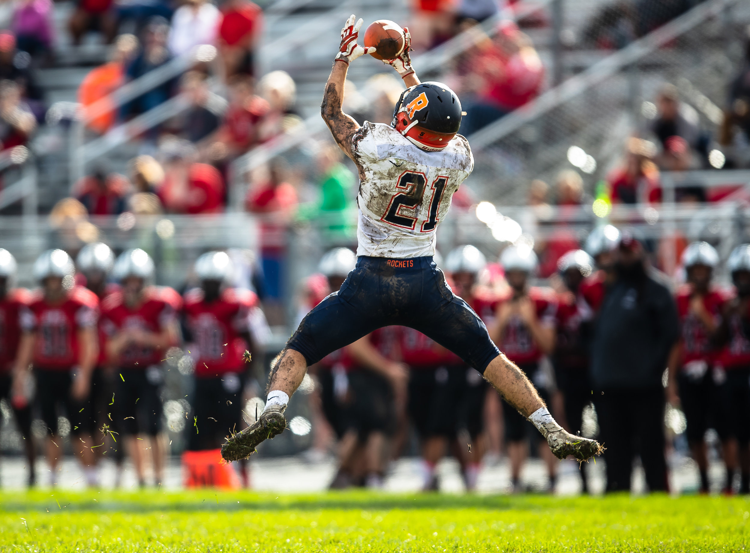 Rochester's David Yoggerst (21) makes a leaping catch against Springfield in the second half at Memorial Stadium, Saturday, Oct. 6, 2018, in Springfield, Ill. [Justin L. Fowler/The State Journal-Register]