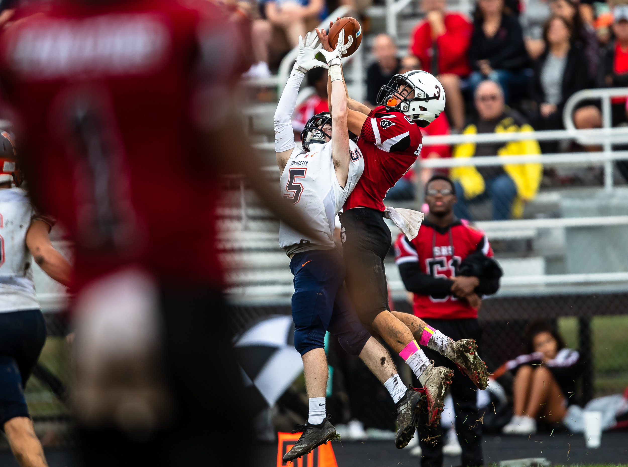 Springfield's Steven Boucher (3) hauls in a catch over Rochester's Chase Hickey (5) in the first half at Memorial Stadium, Saturday, Oct. 6, 2018, in Springfield, Ill. [Justin L. Fowler/The State Journal-Register]