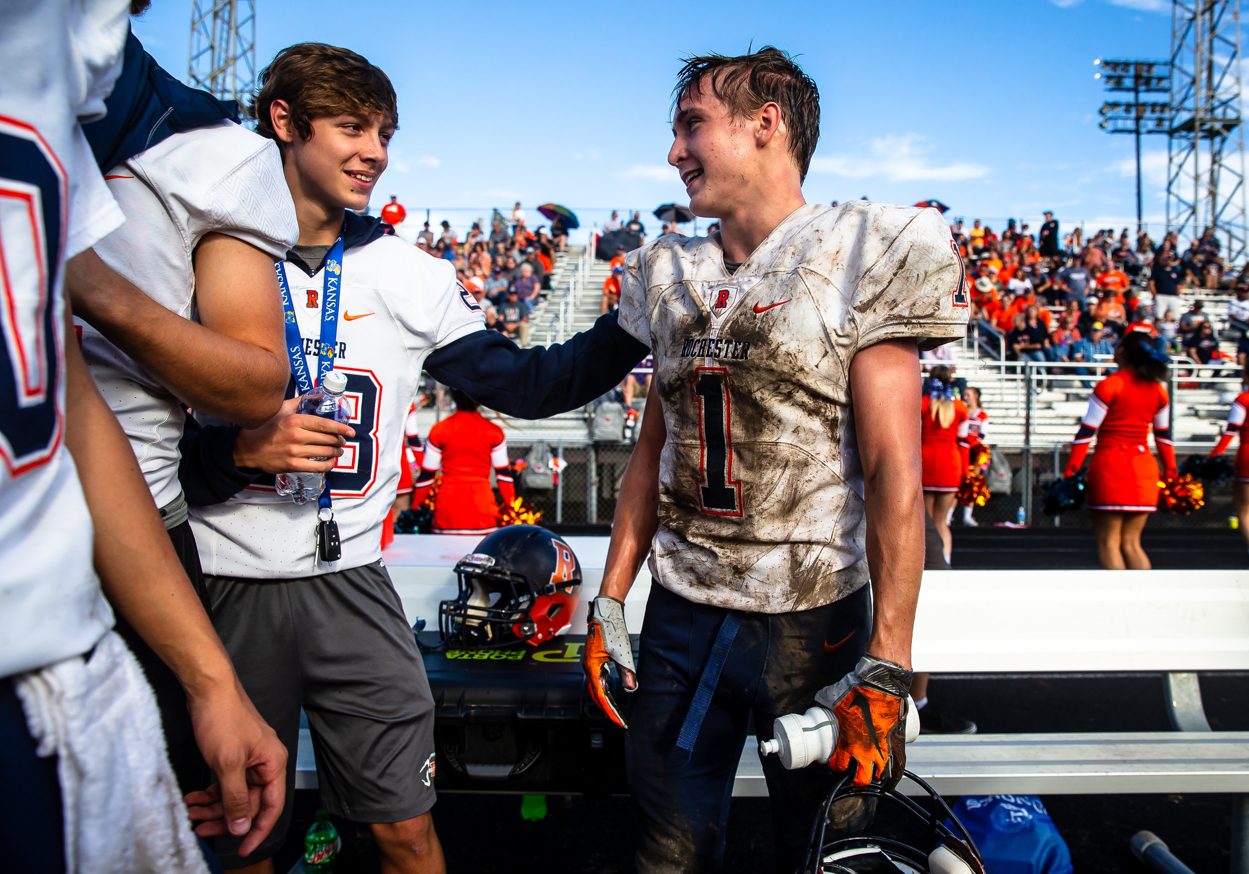 Rochester's Riley Lewis (1) is congratulated along the sidelines after a touchdown against Springfield in the second half at Memorial Stadium, Saturday, Oct. 6, 2018, in Springfield, Ill. [Justin L. Fowler/The State Journal-Register]