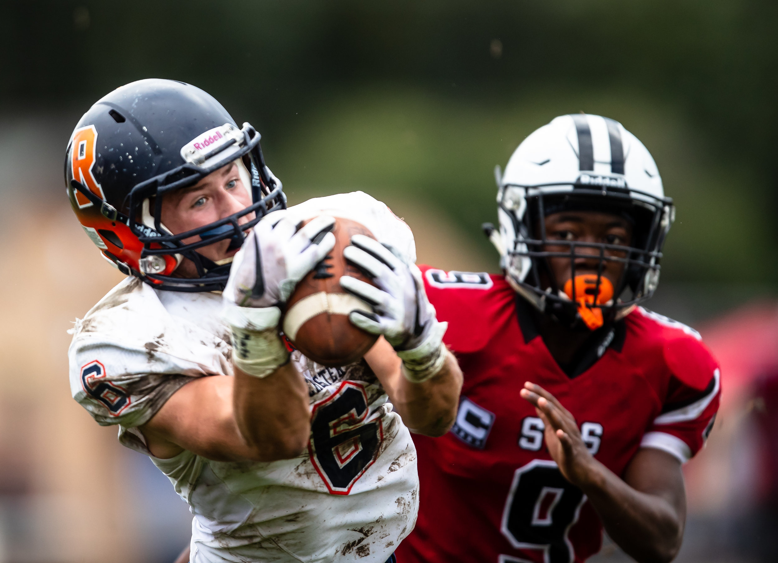 Rochester's Cade Eddington (6) hauls in a pass against Springfield's Jeffery Elms (9) in the first half at Memorial Stadium, Saturday, Oct. 6, 2018, in Springfield, Ill. [Justin L. Fowler/The State Journal-Register]