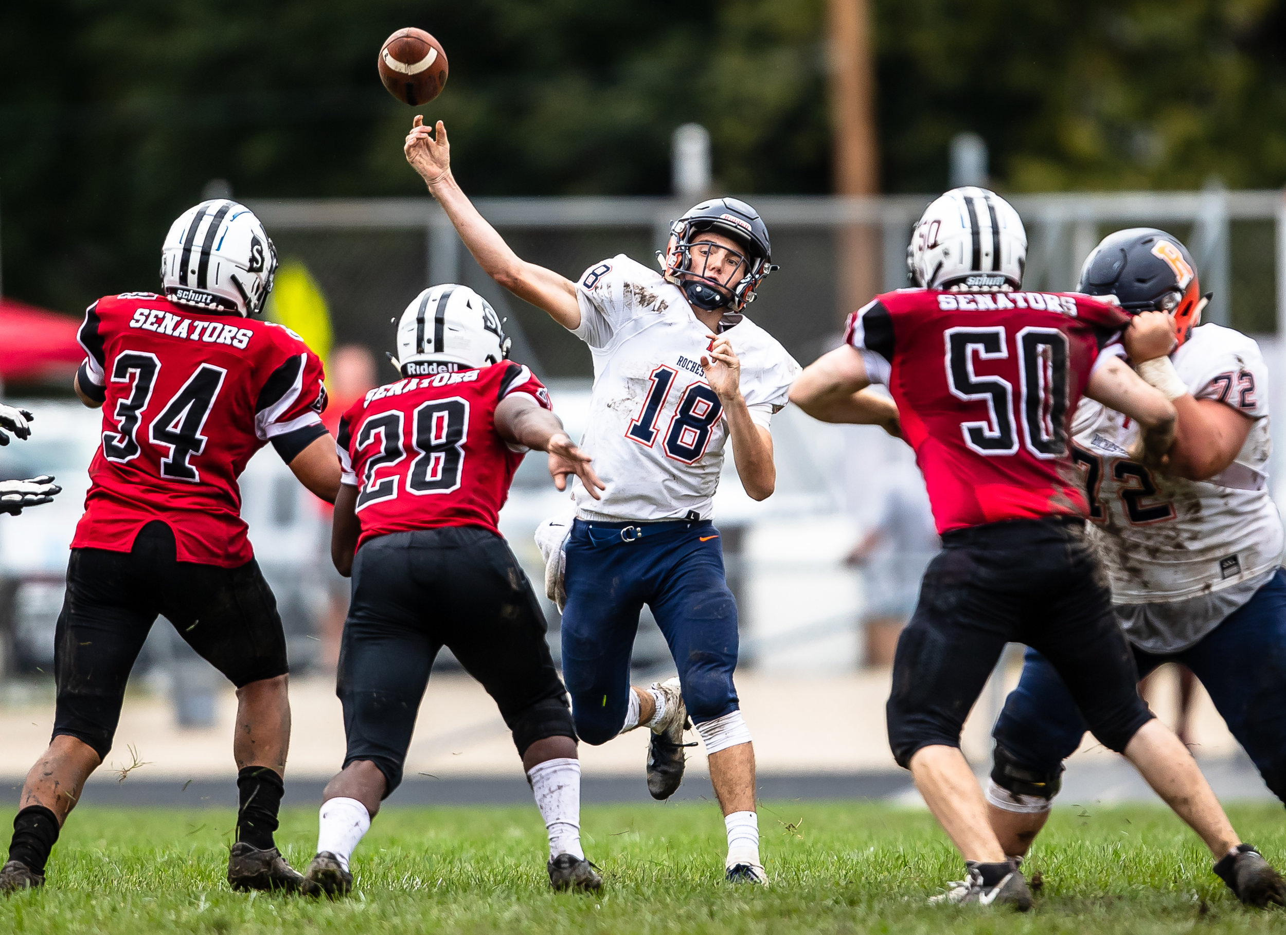 Rochester quarterback Clay Bruno (18) launches a pass against Springfield in the first half at Memorial Stadium, Saturday, Oct. 6, 2018, in Springfield, Ill. [Justin L. Fowler/The State Journal-Register]