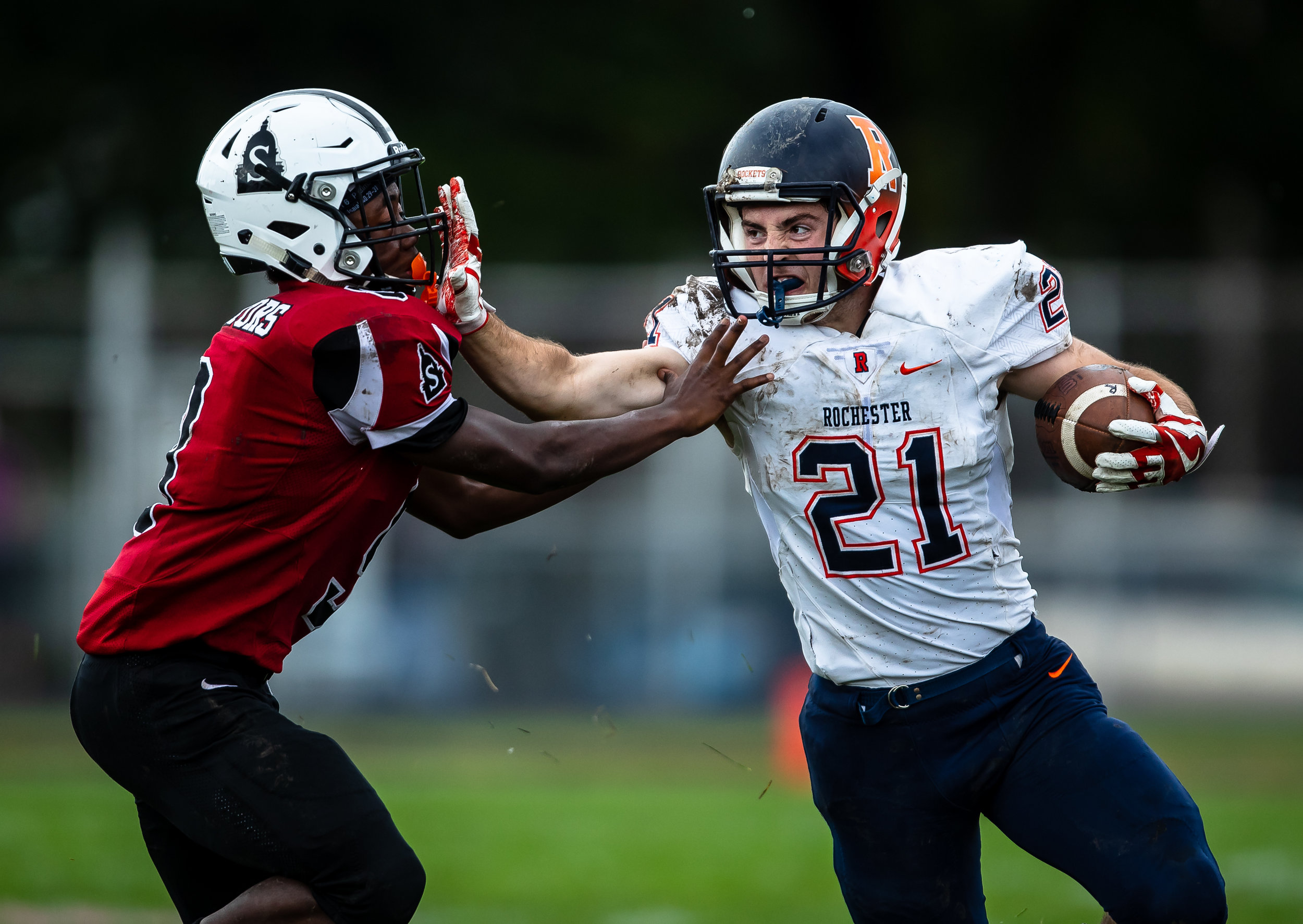 Rochester's David Yoggerst (21) puts a stiff arm on Springfield's Jeffery Elms (9) on a rush in the first half at Memorial Stadium, Saturday, Oct. 6, 2018, in Springfield, Ill. [Justin L. Fowler/The State Journal-Register]
