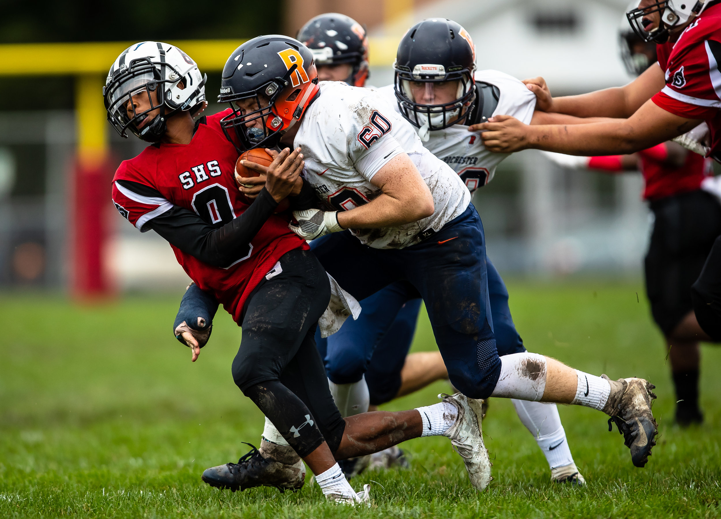 Rochester's Dalton Garecht (60) sacks Springfield quarterback Rashad Rochelle (8) for a loss in the first half at Memorial Stadium, Saturday, Oct. 6, 2018, in Springfield, Ill. [Justin L. Fowler/The State Journal-Register]