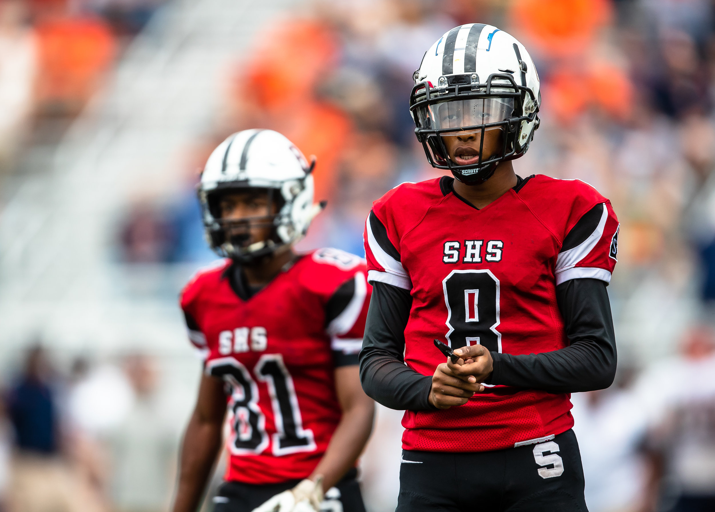 Springfield quarterback Rashad Rochelle (8) gets the play call from the sideline as the Senators take on Rochester in the first half at Memorial Stadium, Saturday, Oct. 6, 2018, in Springfield, Ill. [Justin L. Fowler/The State Journal-Register]