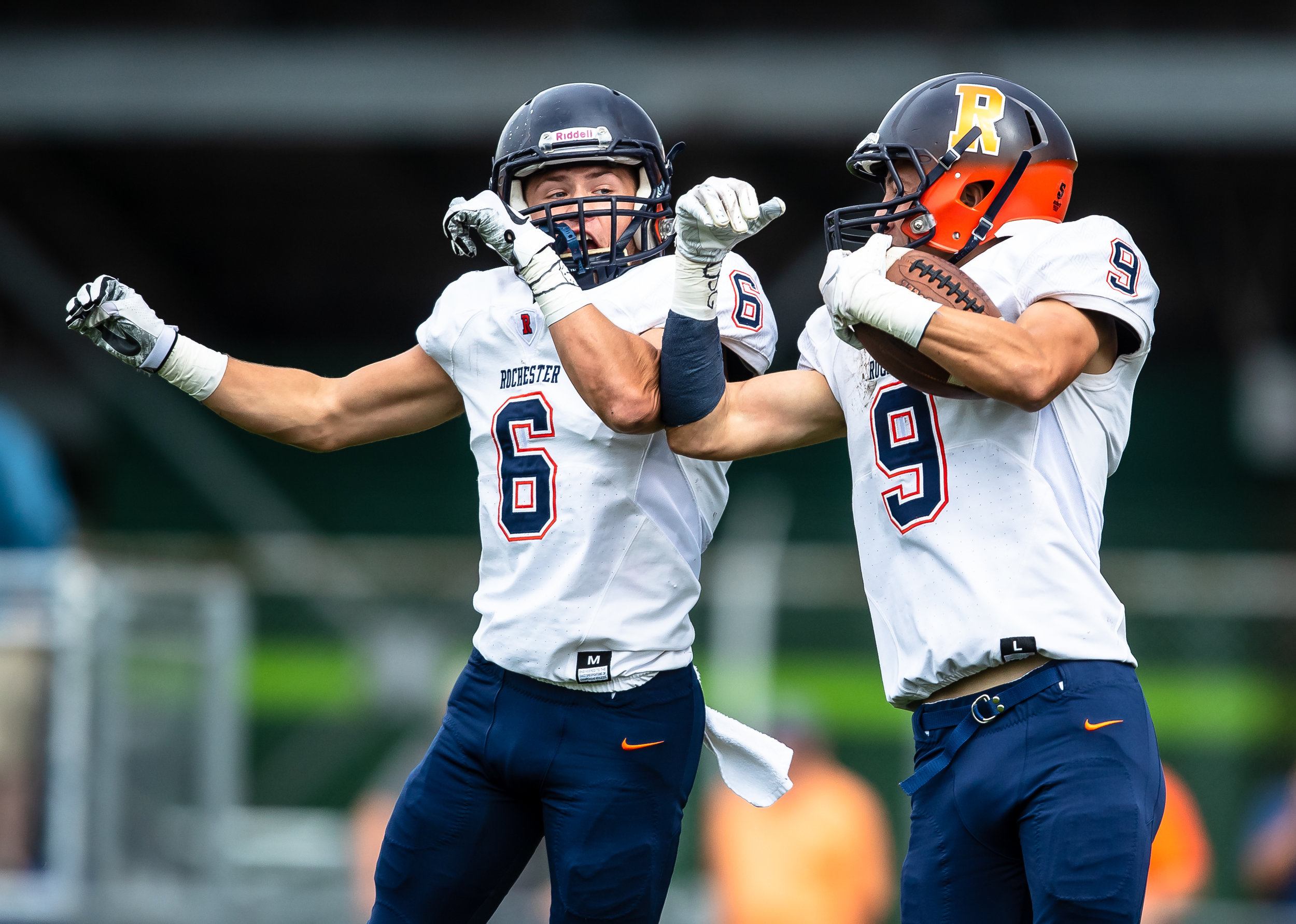Rochester's Clayton Cornett (9) leaps up to celebrate his touchdown with Rochester's Cade Eddington (6) against Springfield in the first half at Memorial Stadium, Saturday, Oct. 6, 2018, in Springfield, Ill. [Justin L. Fowler/The State Journal-Register]