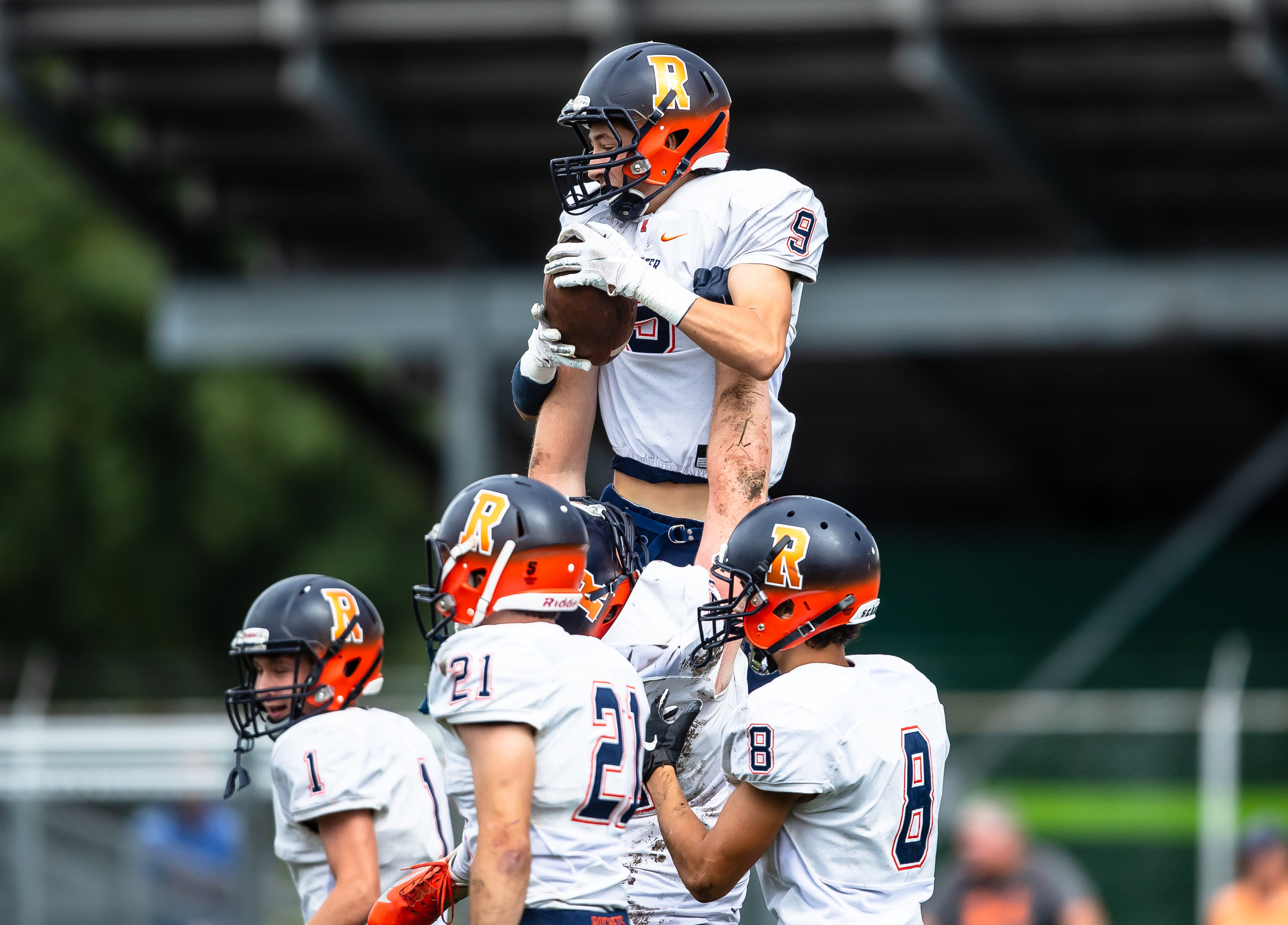 Rochester's Clayton Cornett (9) is hoisted up by Rochester's Camden Ramsey (71) to celebrate his touchdown against Springfield in the first half at Memorial Stadium, Saturday, Oct. 6, 2018, in Springfield, Ill. [Justin L. Fowler/The State Journal-Register]