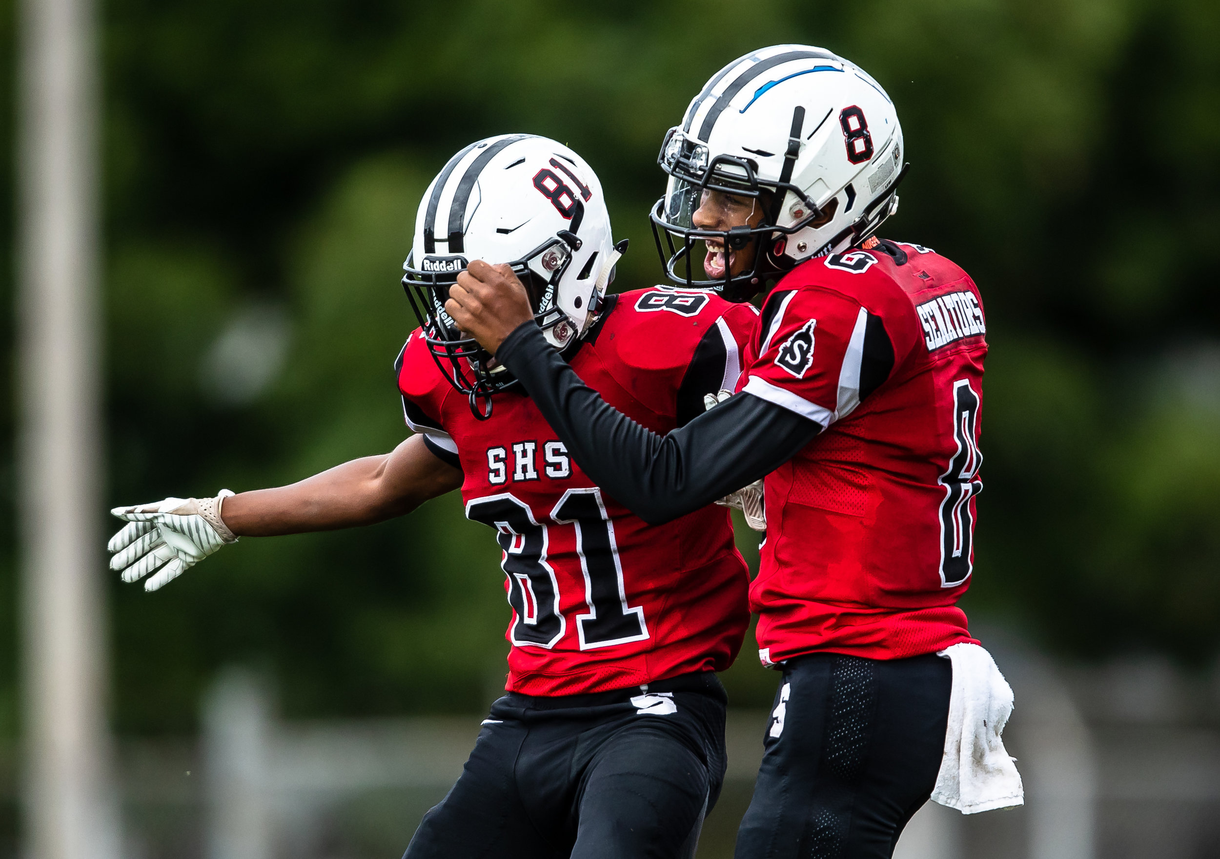 Springfield's John Waddy (81) celebrates his touchdown with Springfield quarterback Rashad Rochelle (8) against Rochester in the first half at Memorial Stadium, Saturday, Oct. 6, 2018, in Springfield, Ill. [Justin L. Fowler/The State Journal-Register]