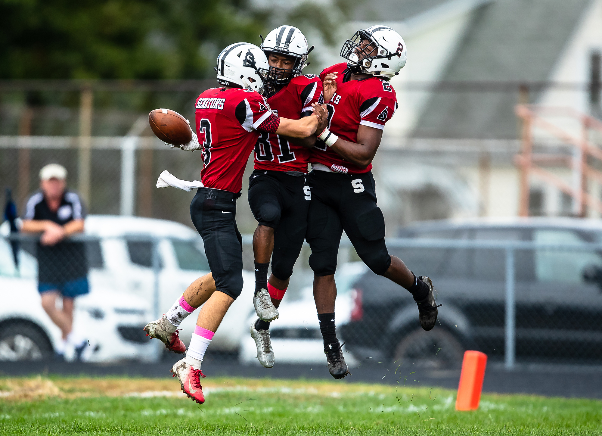 Springfield's John Waddy (81) celebrates his touchdown against Rochester with Springfield's Taryn Wallace (2) and Springfield's Steven Boucher (3) in the first half at Memorial Stadium, Saturday, Oct. 6, 2018, in Springfield, Ill. [Justin L. Fowler/The State Journal-Register]