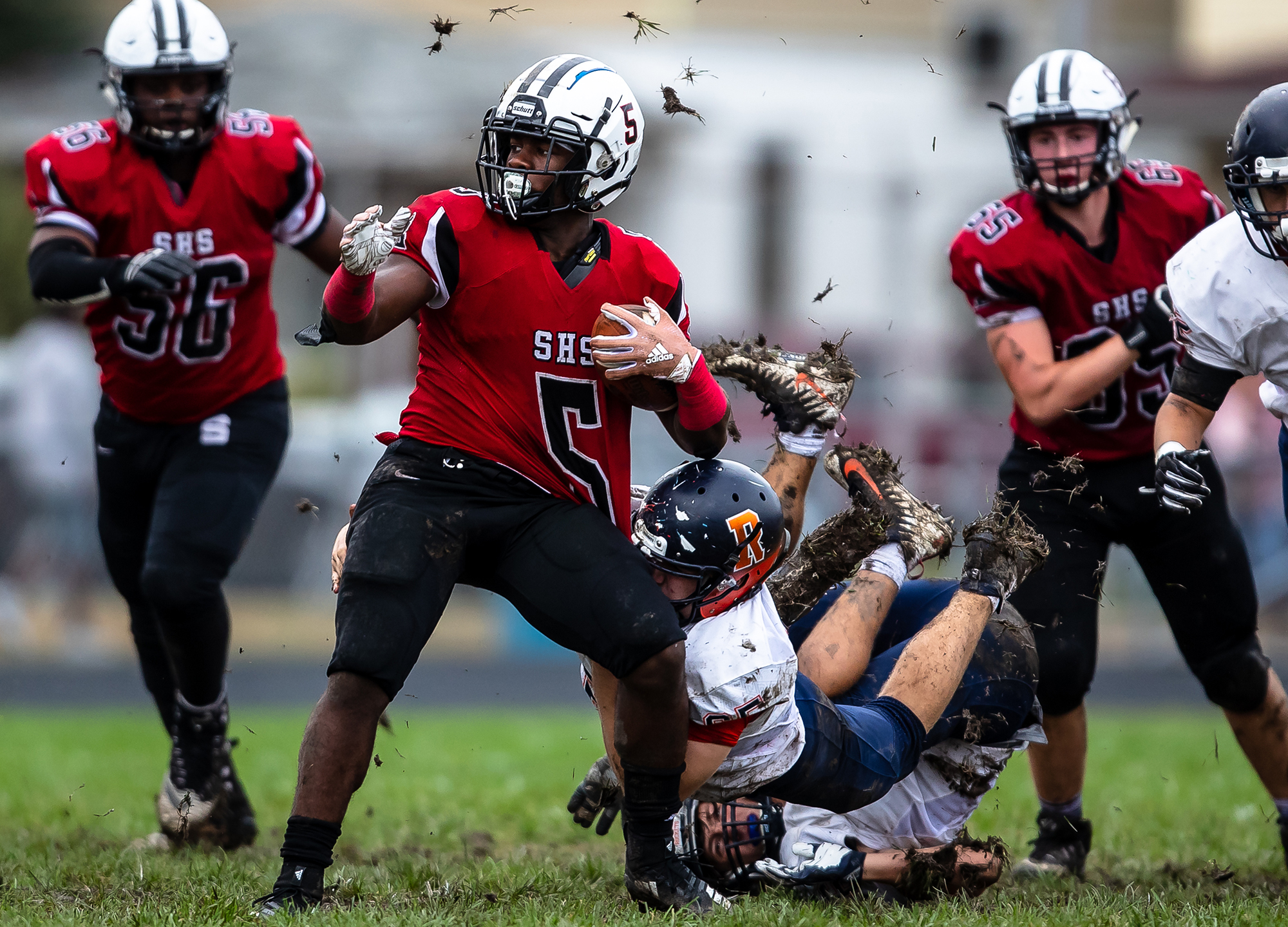 Rochester's Mitchell Morris (65) brings Springfield's Justin Bivins II (5) down by his jersey on a rush in the first half at Memorial Stadium, Saturday, Oct. 6, 2018, in Springfield, Ill. [Justin L. Fowler/The State Journal-Register]