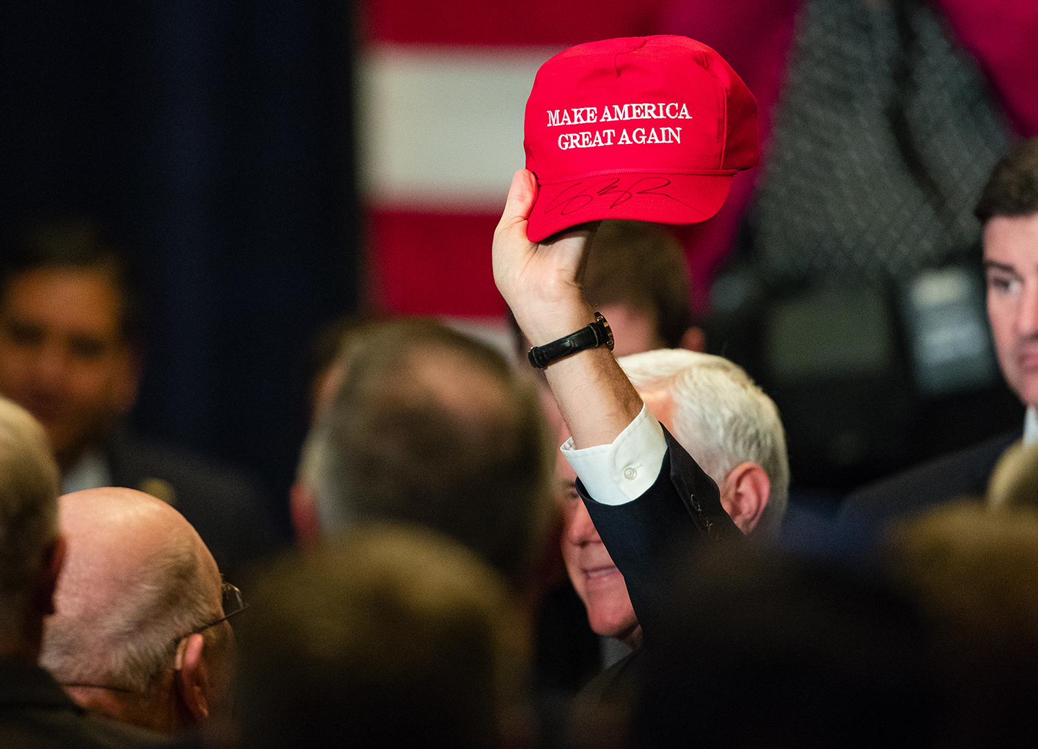 Vice President Mike Pence holds an autographed Make America Great Again hat high as he campaigns for Rodney Davis, R-Taylorville, at Panther Creek Country Club in Springfield, Ill., Friday, Oct. 12, 2018. Davis is locked in a nationally watched race for the 13th Congressional District against Democrat Betsy Dirksen Londrigan of Springfield.  [Ted Schurter/The State Journal-Register]