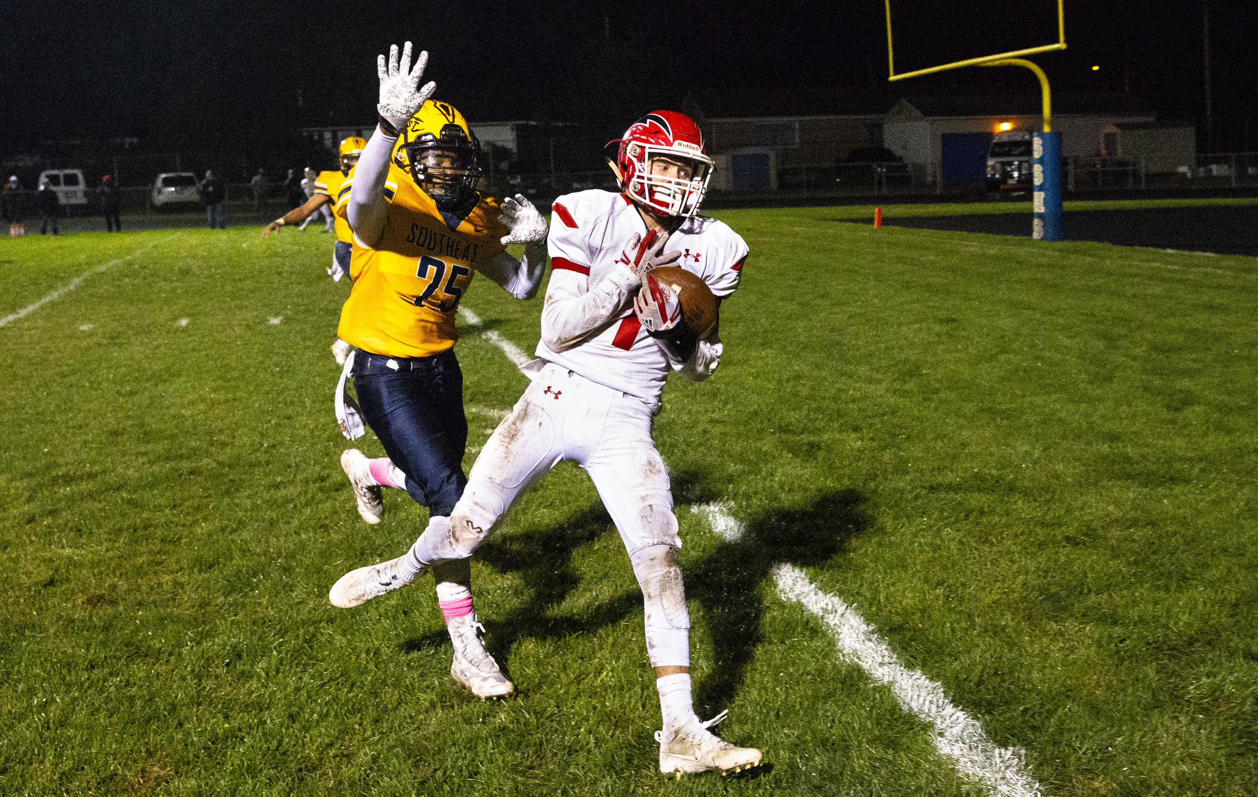 Glenwood's Drew Dunbar brings in a pass for a touchdown with Southeast's Tavaris Lane defending to put the Titans up 45-14 in the third quarter Friday, Oct. 12, 2018 at Southeast High School's Spartan Field in Springfield, Ill. [Rich Saal/The State Journal-Register]