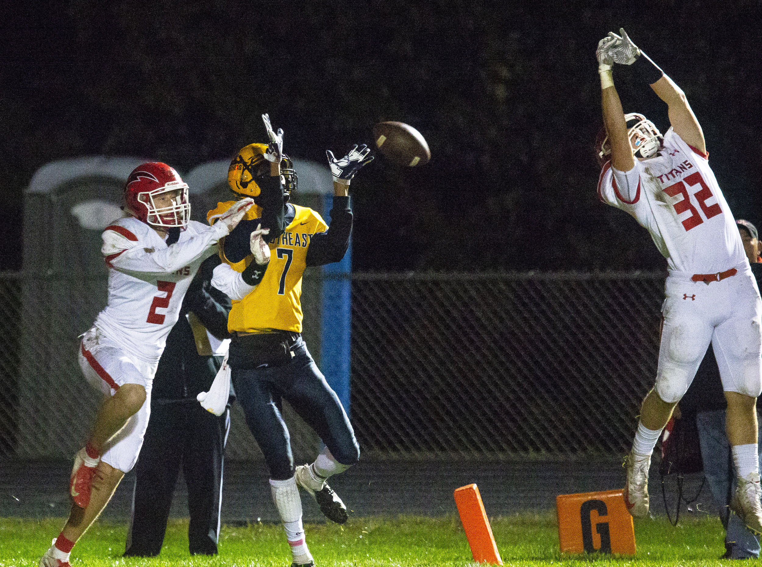 Glenwood's Jake Wooldridge, right, breaks up a pass intended for Southeast's Karlous Perry at the end of the second quarter Friday, Oct. 12, 2018 at Southeast High School's Spartan Field in Springfield, Ill. Glenwood's Conley Price was also defending. [Rich Saal/The State Journal-Register]