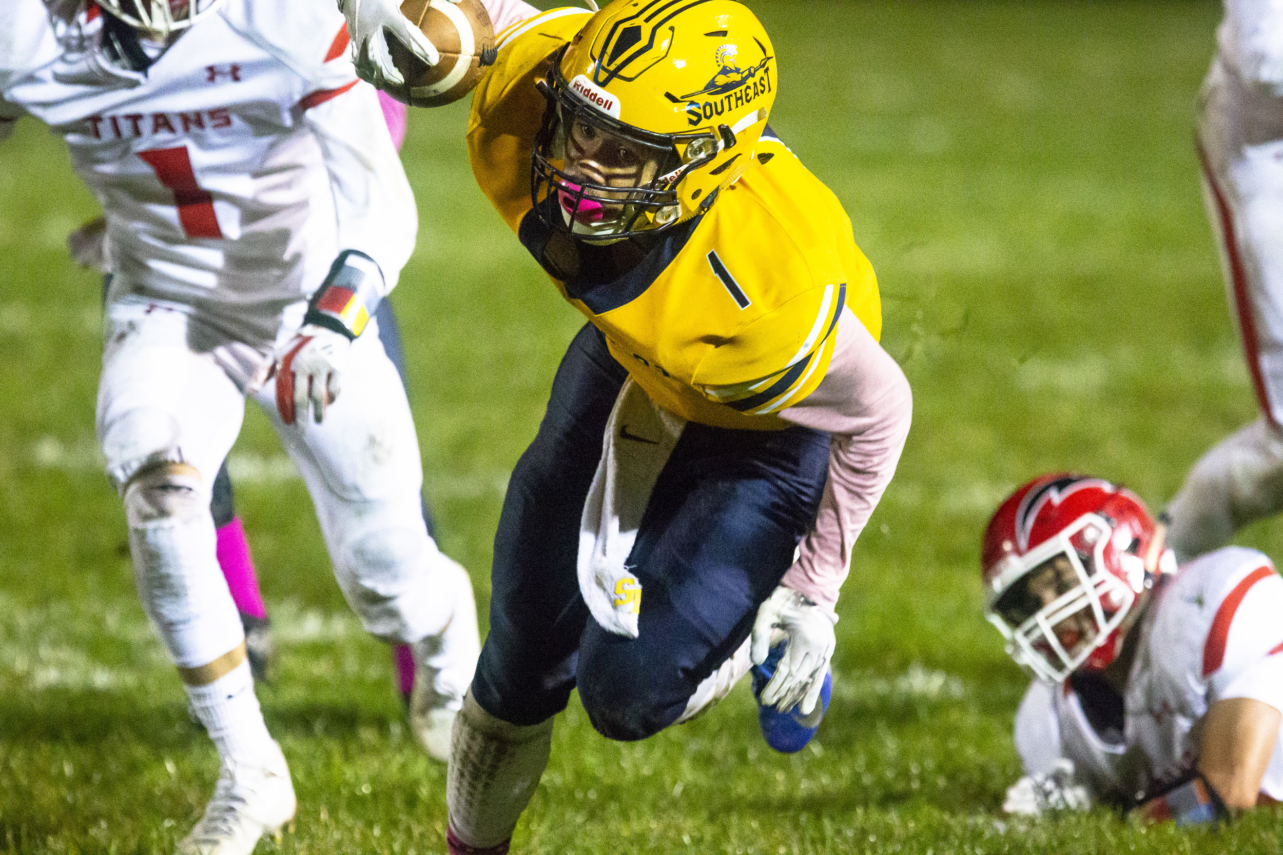 Southeast's Isaiah Cooper scrambles for extra yardage Friday, Oct. 12, 2018 at Southeast High School's Spartan Field in Springfield, Ill. [Rich Saal/The State Journal-Register]