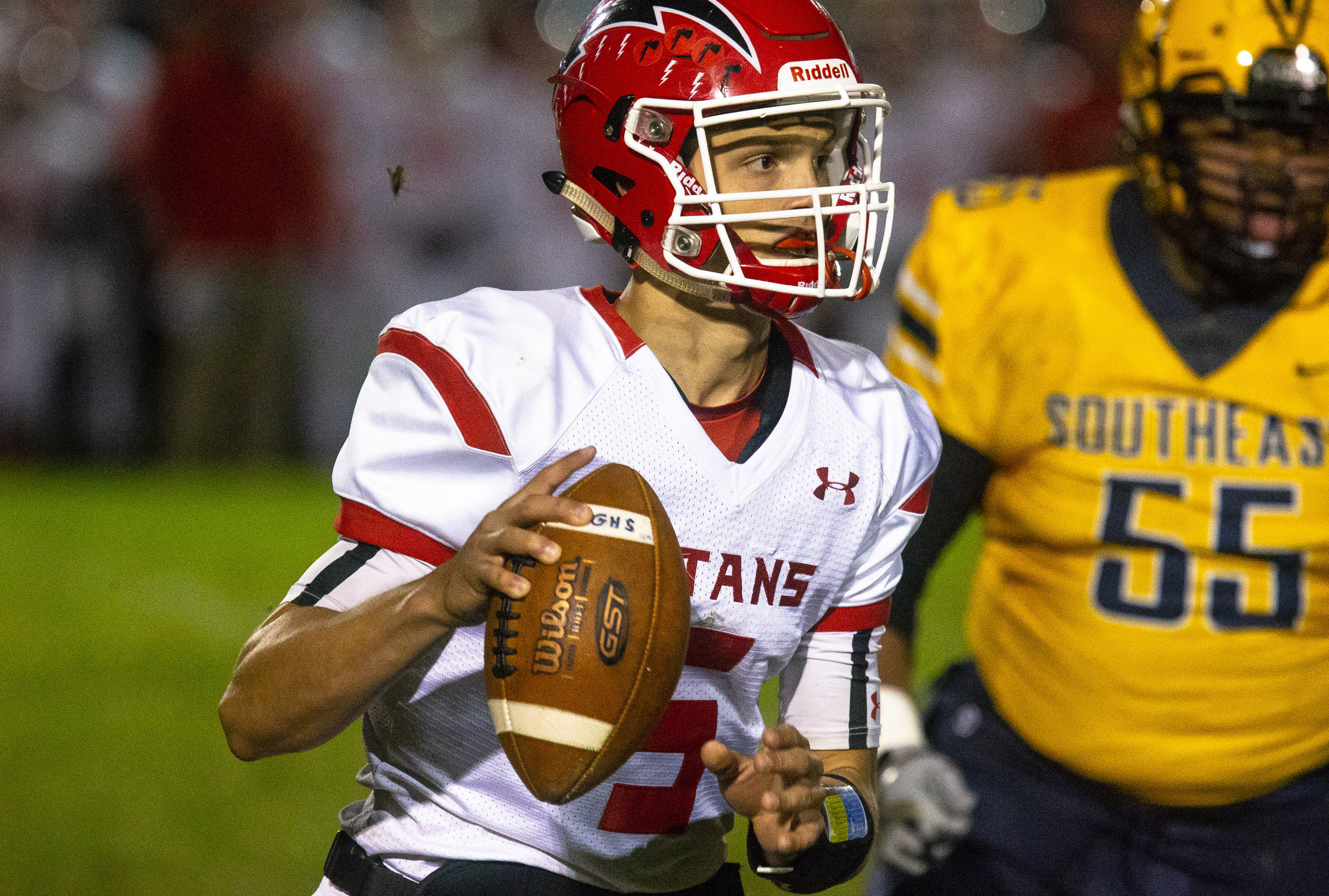 Glenwood quarterback Luke Lehnen looks for an open receiver Friday, Oct. 12, 2018 at Southeast High School's Spartan Field in Springfield, Ill. [Rich Saal/The State Journal-Register]