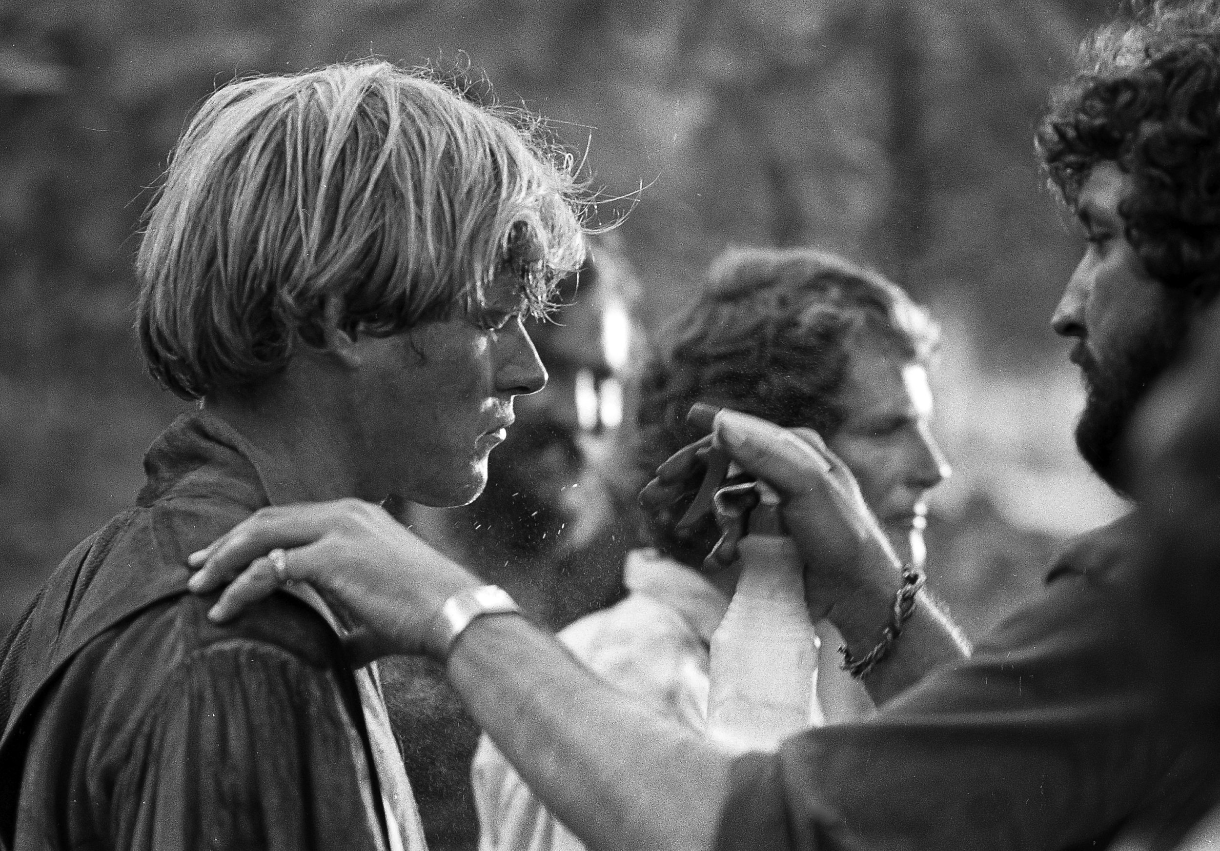 """Brian Kerwin, who plays Gideon Chisholm, has water sprayed on his face to look sweaty before filming a scene for the television mini series """"The Chisholms"""" at New Salem State Historic Site, October 2, 1978. Behind Kerwin is actor Ben Murphy. File/Bill Hagen/The State Journal-Register"""