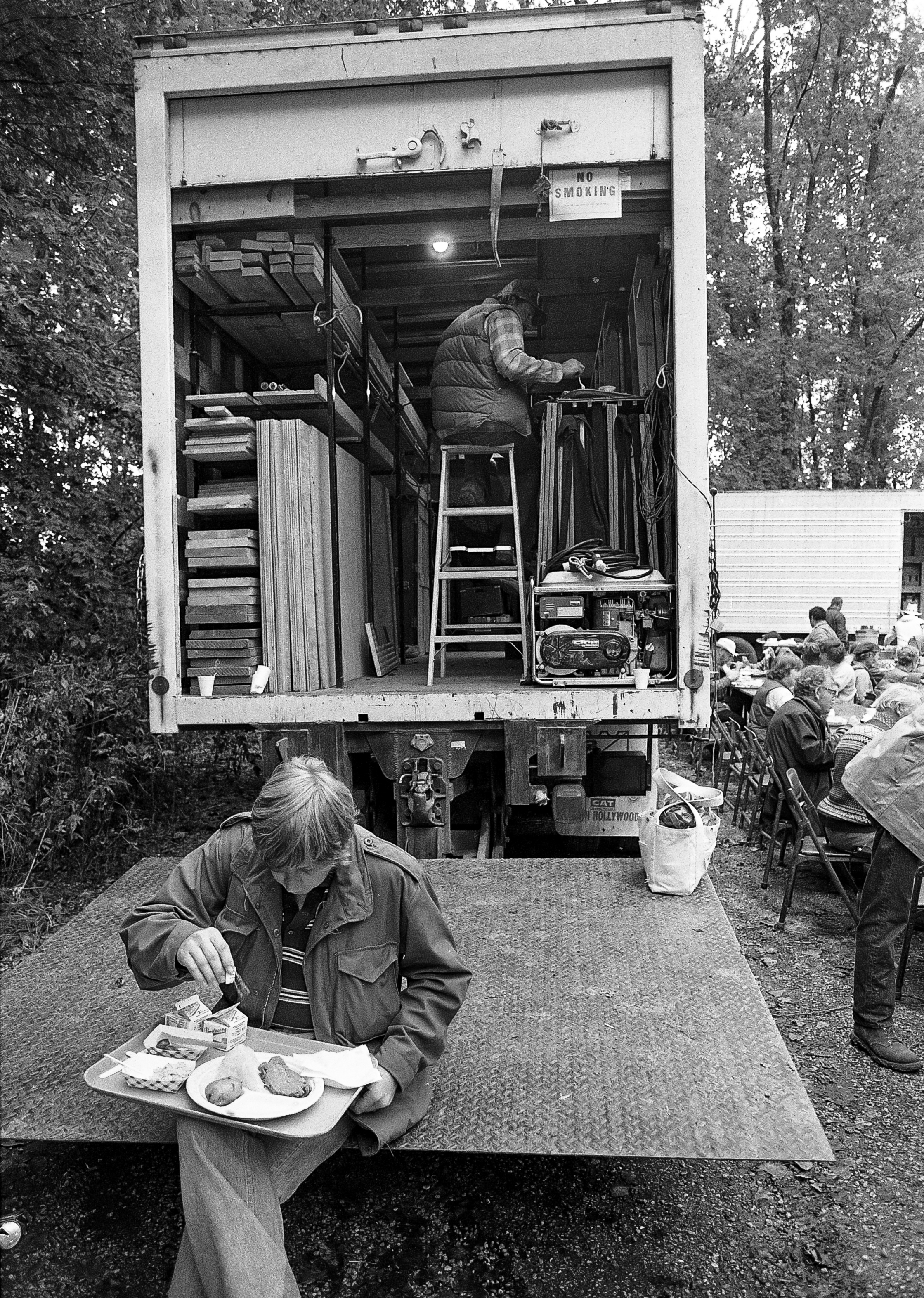 """A member of the production crew grabs lunch during filming of the television mini series """"The Chisholms"""" at New Salem State Historic Site, October 2, 1978. File/Bill Hagen/The State Journal-Register"""