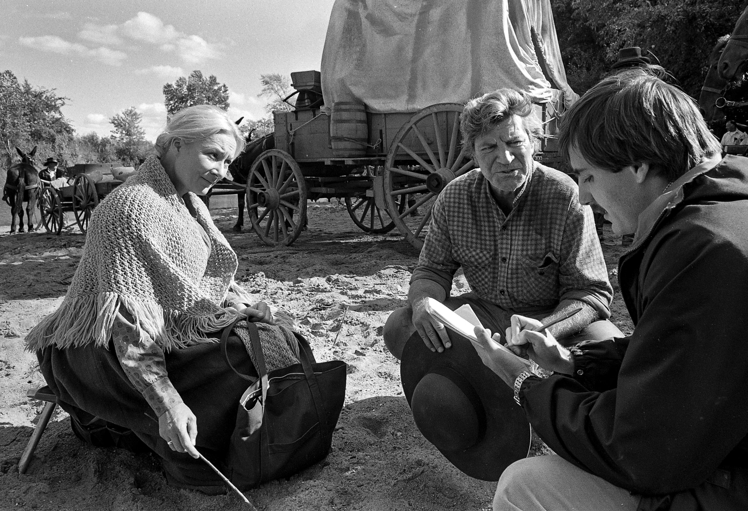 """Lead actors Rosemay Harris and Robert Preston talk to Steve Slack, a reporter for The State Journal-Register, during a break in filming for the television mini series """"The Chisholms"""" at New Salem State Historic Site, October 2, 1978. File/Bill Hagen/The State Journal-Registerentertainment; Hollywood; television; Rosemary Harris; Robert Preston; Ben Murphy; James Van Patten; Susan Swift; archive; spihistory; picpast"""