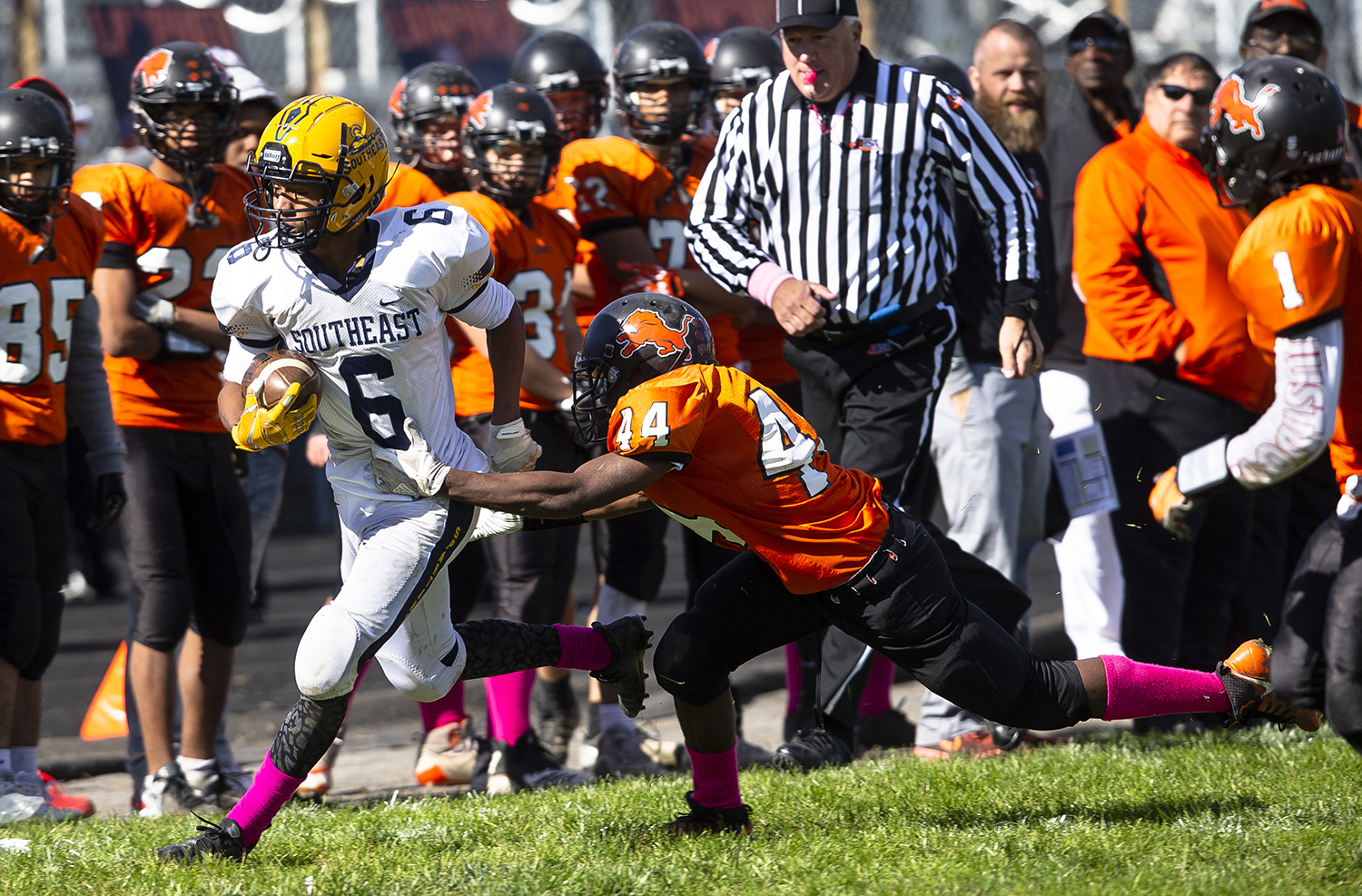 Southeast's Deon Fairlee skirts the sidelines with Lanphier's Tierre Butler in tow at Memorial Stadium Saturday, Oct. 20, 2018 in Springfield, Ill. [Rich Saal/The State Journal-Register]