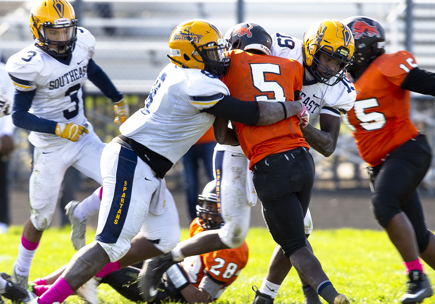 Southeast defenders Ben Gippleh (8), left, and Devin Blue-Robinson (19) wrap up Lanphier's Narkel Leflore at Memorial Stadium Saturday, Oct. 20, 2018  in Springfield, Ill. [Rich Saal/The State Journal-Register]