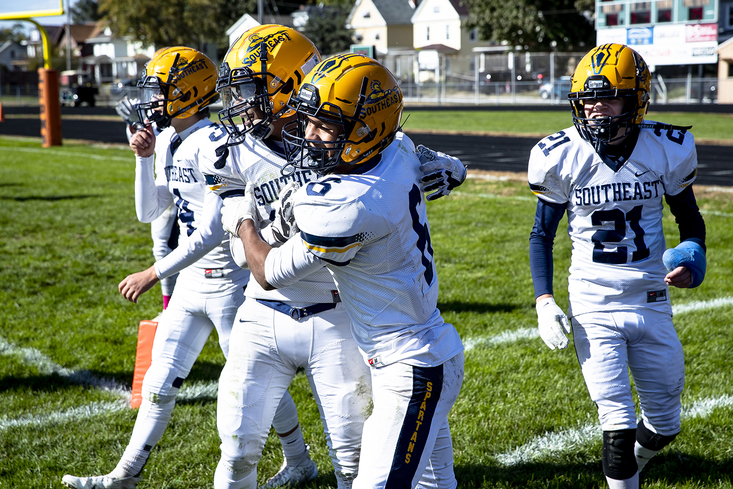 Southeast's Deon Fairlee (6) celebrates with teammates after returning a Lanphier kick into the end zone for a touchdown during the third quarter at Memorial Stadium Saturday, Oct. 20, 2018  in Springfield, Ill. [Rich Saal/The State Journal-Register]