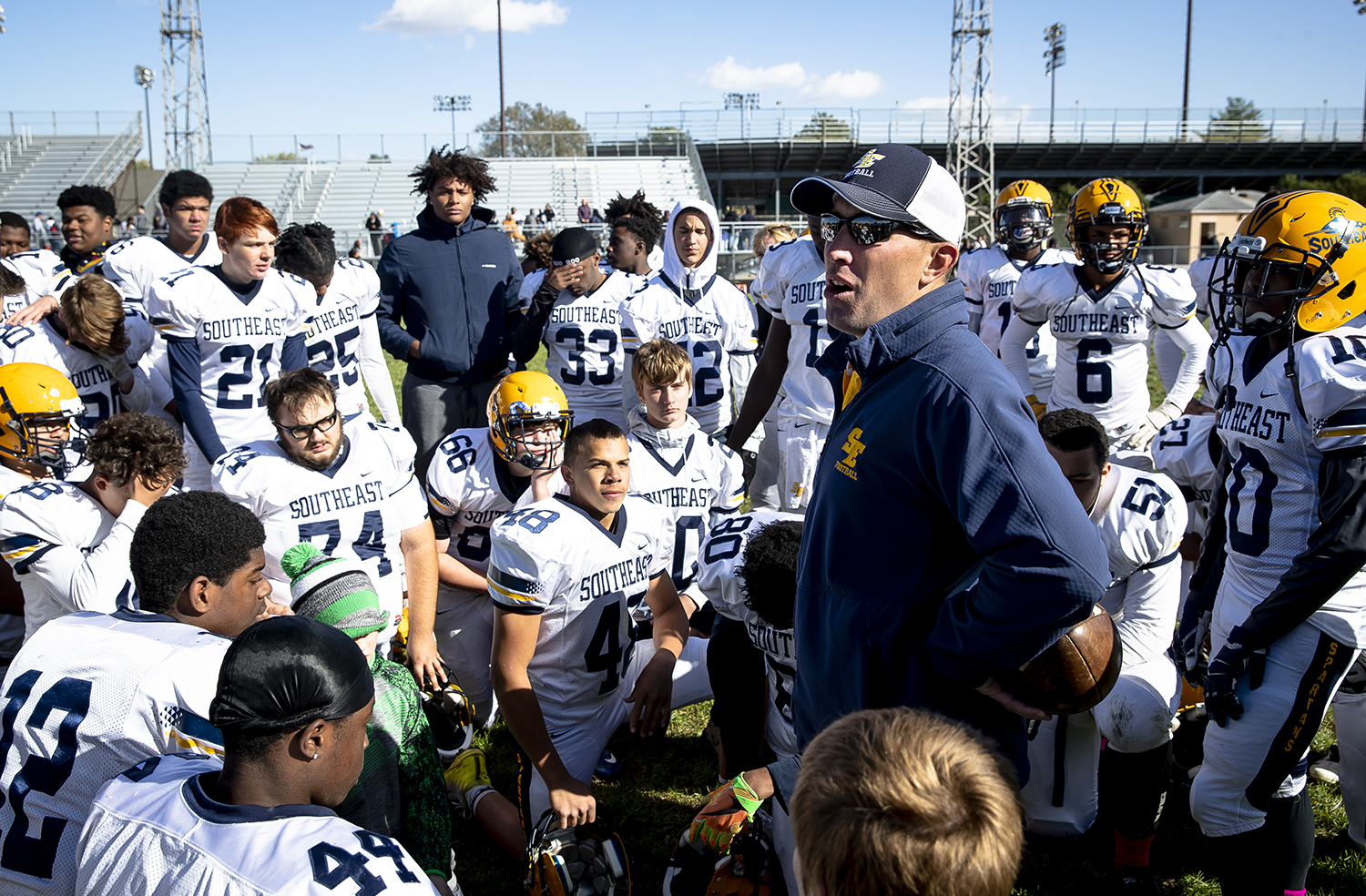 Southeast head coach Matt Lauber thanks his team for their work during the season at Memorial Stadium after the Spartans defeated Lanphier 44-12 to finish 4-5 for the season Saturday, Oct. 20, 2018 in Springfield, Ill. [Rich Saal/The State Journal-Register]