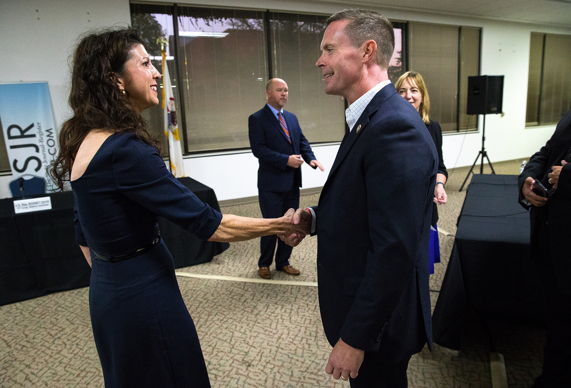 Democrat Betsy Dirksen Londrigan, left, greets Rodney Davis, R-Taylorville, before a debate at The State Journal-Register Monday, Oct. 15, 2018. The two are running for the 13th Congressional District. [Ted Schurter/The State Journal-Register]