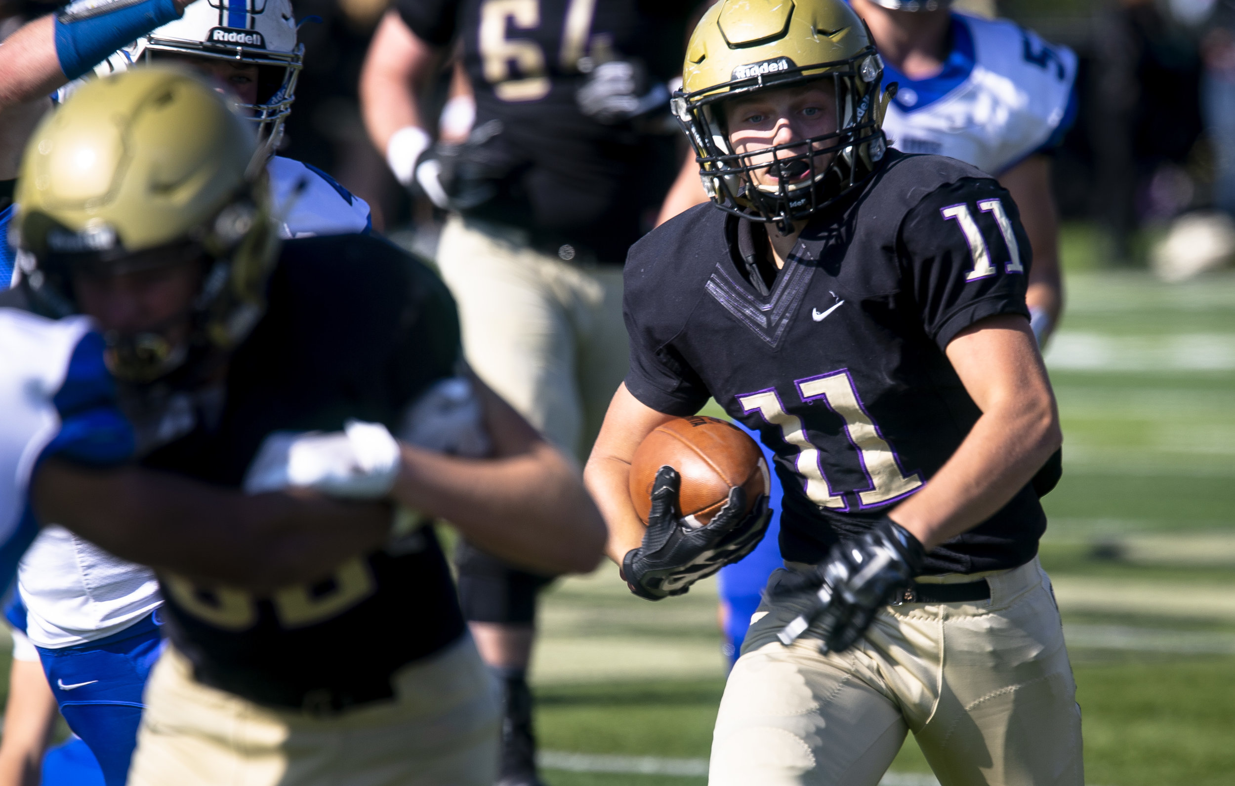 Sacred Heart-Griffin's Cade Holloway looks for running room in a Class 6A playoff game against Quincy Saturday, Oct. 27, 2018 at Ken Leonard Field in Springfield, Ill. [Rich Saal/The State Journal-Register]