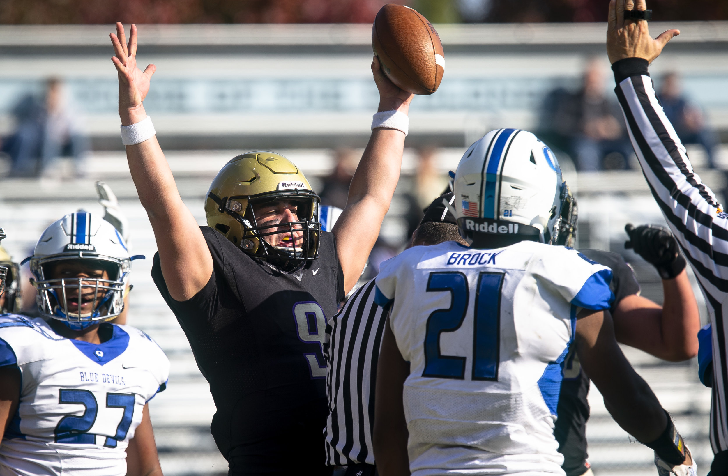 Sacred Heart-Griffin's Sam Sweetland celebrates a quarterback keeper that was good for a fourth quarter touchdown to put the Cyclones up 33-14 over the Quincy Blue Devils in a Class 6A playoff game Saturday, Oct. 27, 2018 at Ken Leonard Field in Springfield, Ill. [Rich Saal/The State Journal-Register]