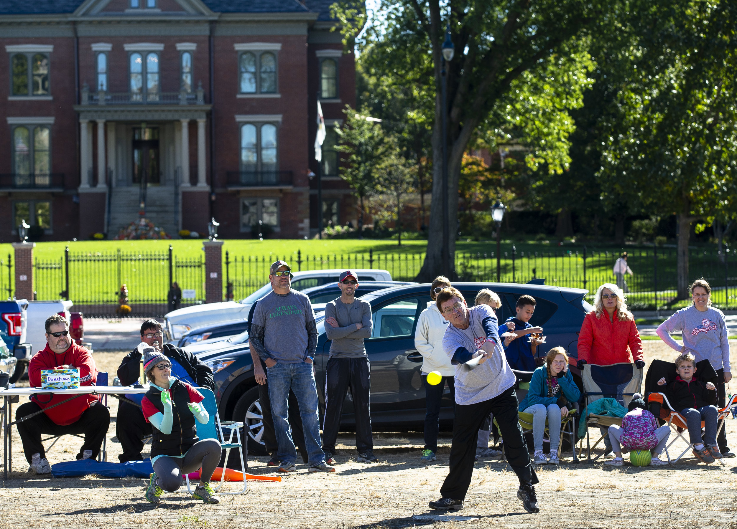 Mayor Jim Langfelder swings and misses at the plate during a whiffle ball game between city and county officials on the former YWCA block Sunday, Oct. 21, 2018 in Springfield, Ill. The city team topped the county 5-2, and then faced the winner of a game between radio and television news personalities, which they won 11-3. Money raised from the game will benefit the Land of Lincoln Honor Flight. Go to www.sj-r.com to see more pictures. [Rich Saal/The State Journal-Register]