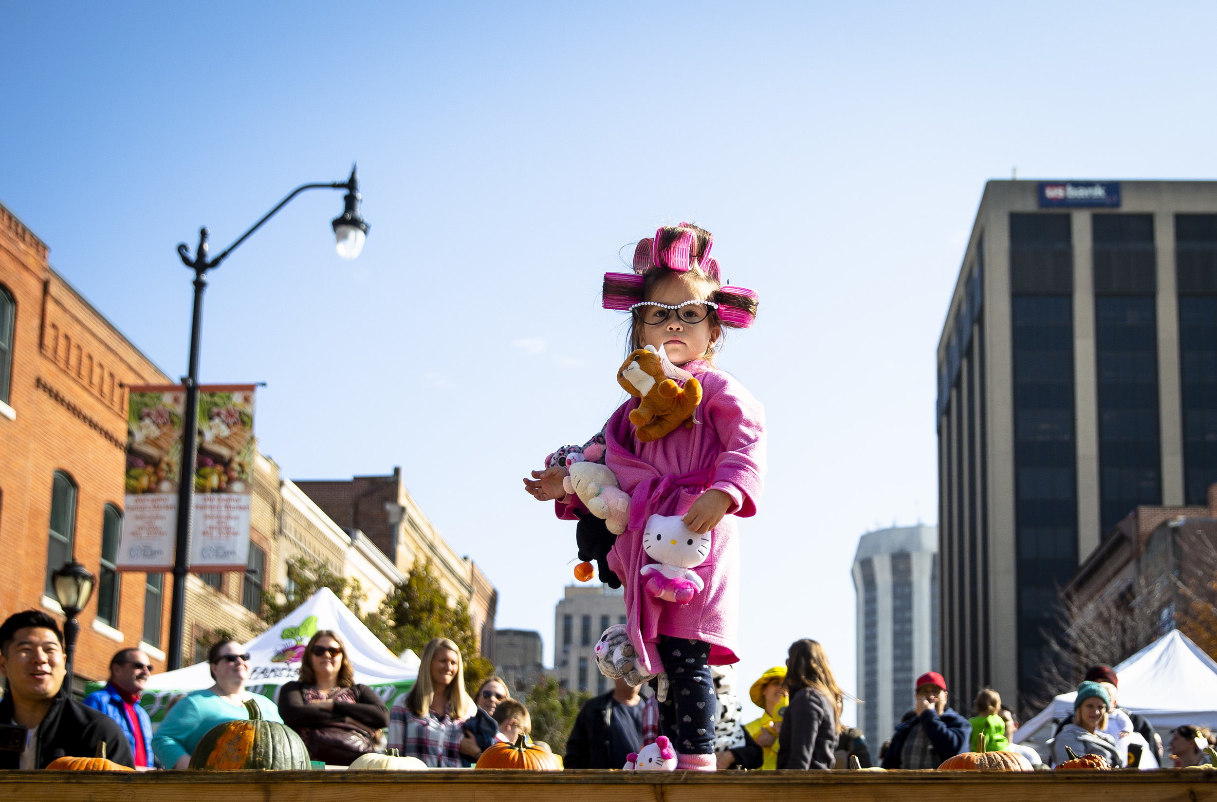 Karin Houzenga, 3, dressed as a crazy cat lady, walks the runway during the costume contest at the Halloween at the Market event Saturday, Oct. 27, 2018 at the Old Capitol Farmer's Market in Springfield, Ill. Sponsored by Downtown Springfield, Inc., the annual event wraps up the end of the market season. [Rich Saal/The State Journal-Register]