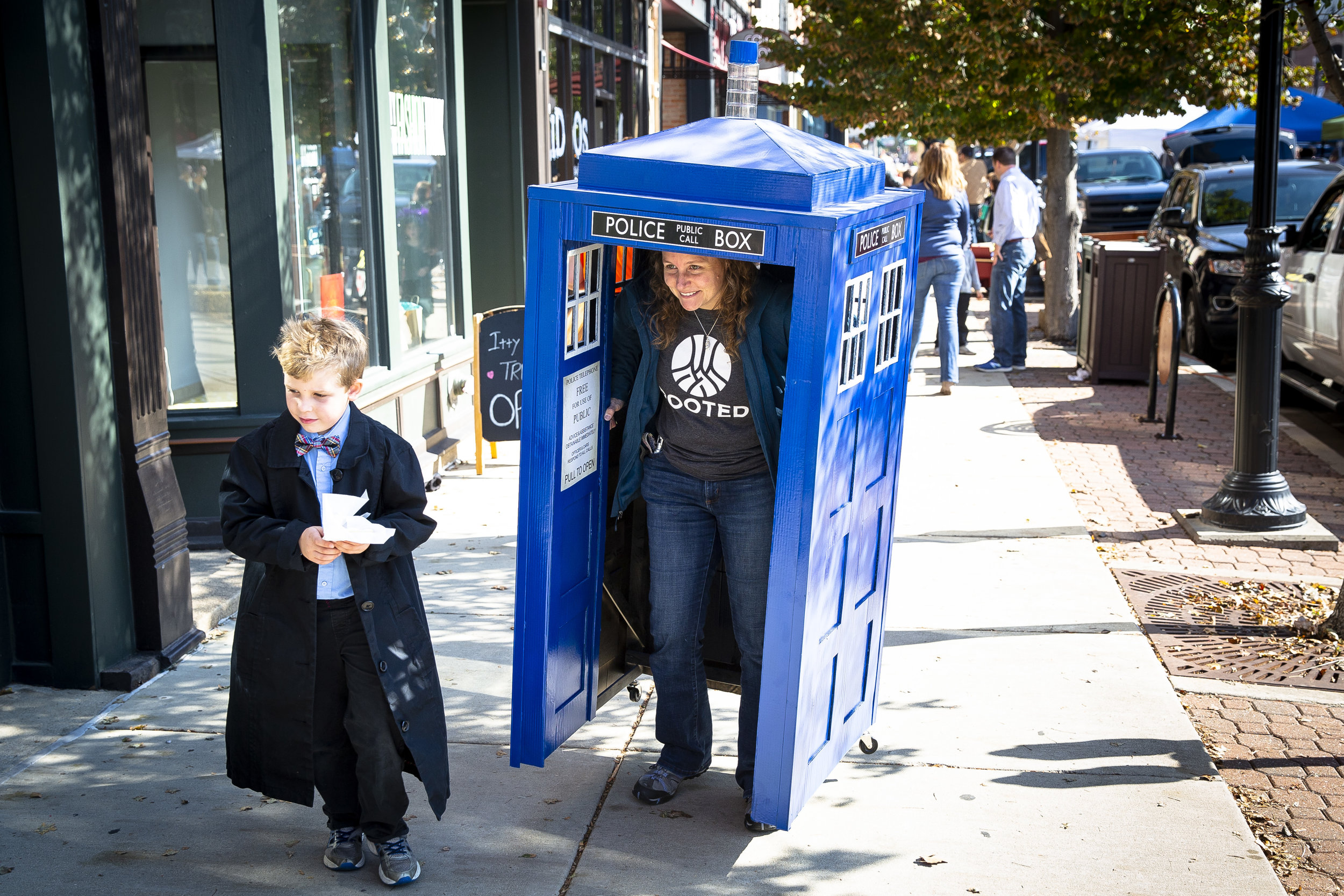 Jennifer Lair wears a police call box that she built for the family costume contest that she entered with her son, Logan, 6, during the Halloween at the Market Saturday, Oct. 27, 2018 at the Old Capitol Farmer's Market in Springfield, Ill. [Rich Saal/The State Journal-Register]