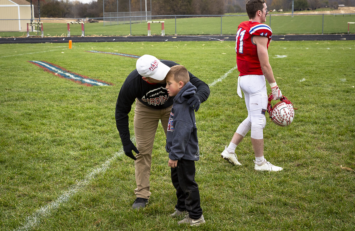 Pleasant Plains' Head Coach John Hambelton talks with his son, Ty, after the Cardinals' loss to Greenville in the Class 2A playoff game Saturday, Nov. 3, 2018 at Pleasant Plains High School in Pleasant Plains, Ill. [Rich Saal/The State Journal-Register]