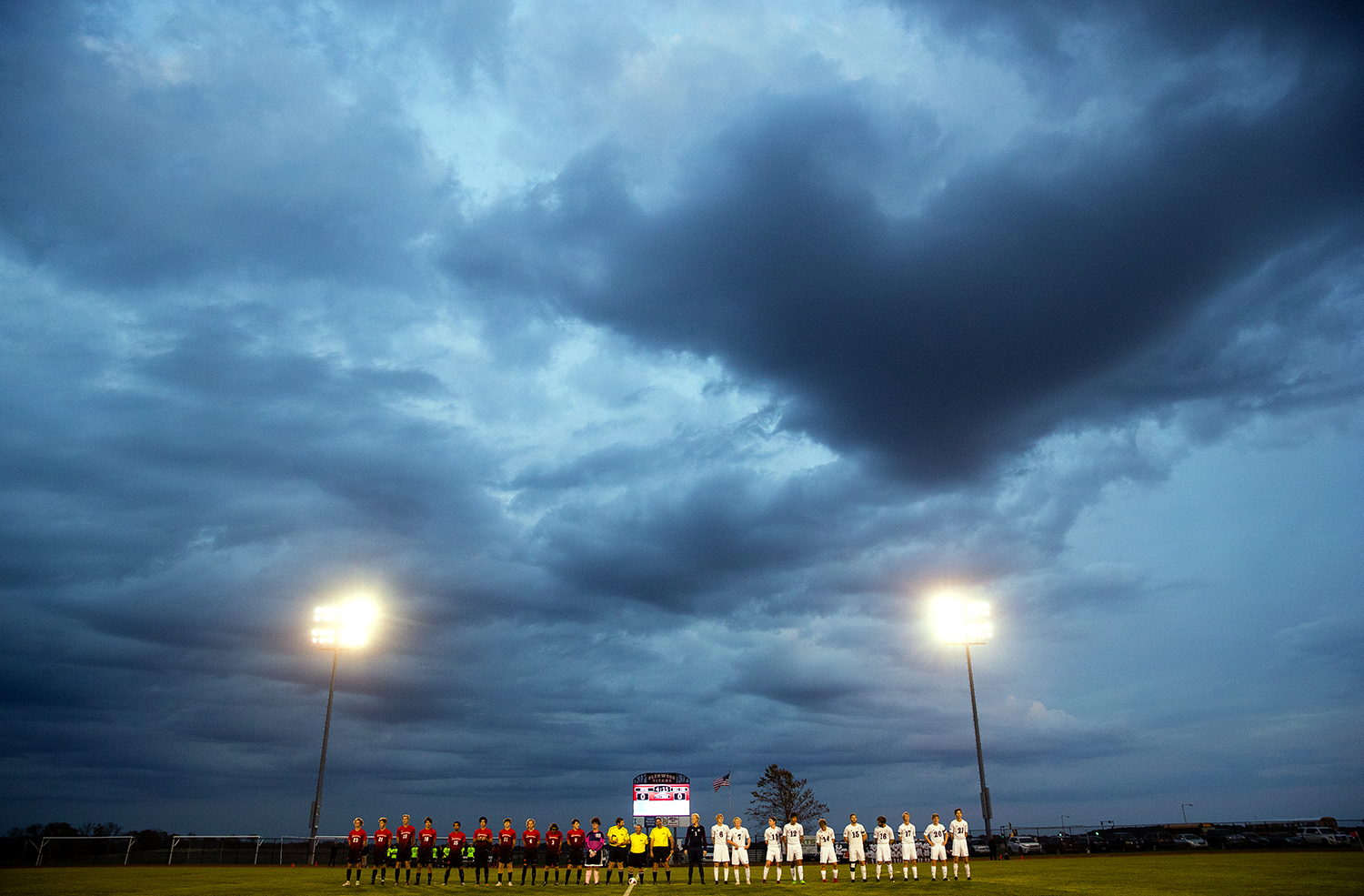 Springfield, left, and Gibault Catholic stand for introductions under a cloudy sky before the IHSA Class 2A Glenwood Soccer Supersectional at Glenwood High School Tuesday, Oct. 30, 2018. [Ted Schurter/The State Journal-Register]