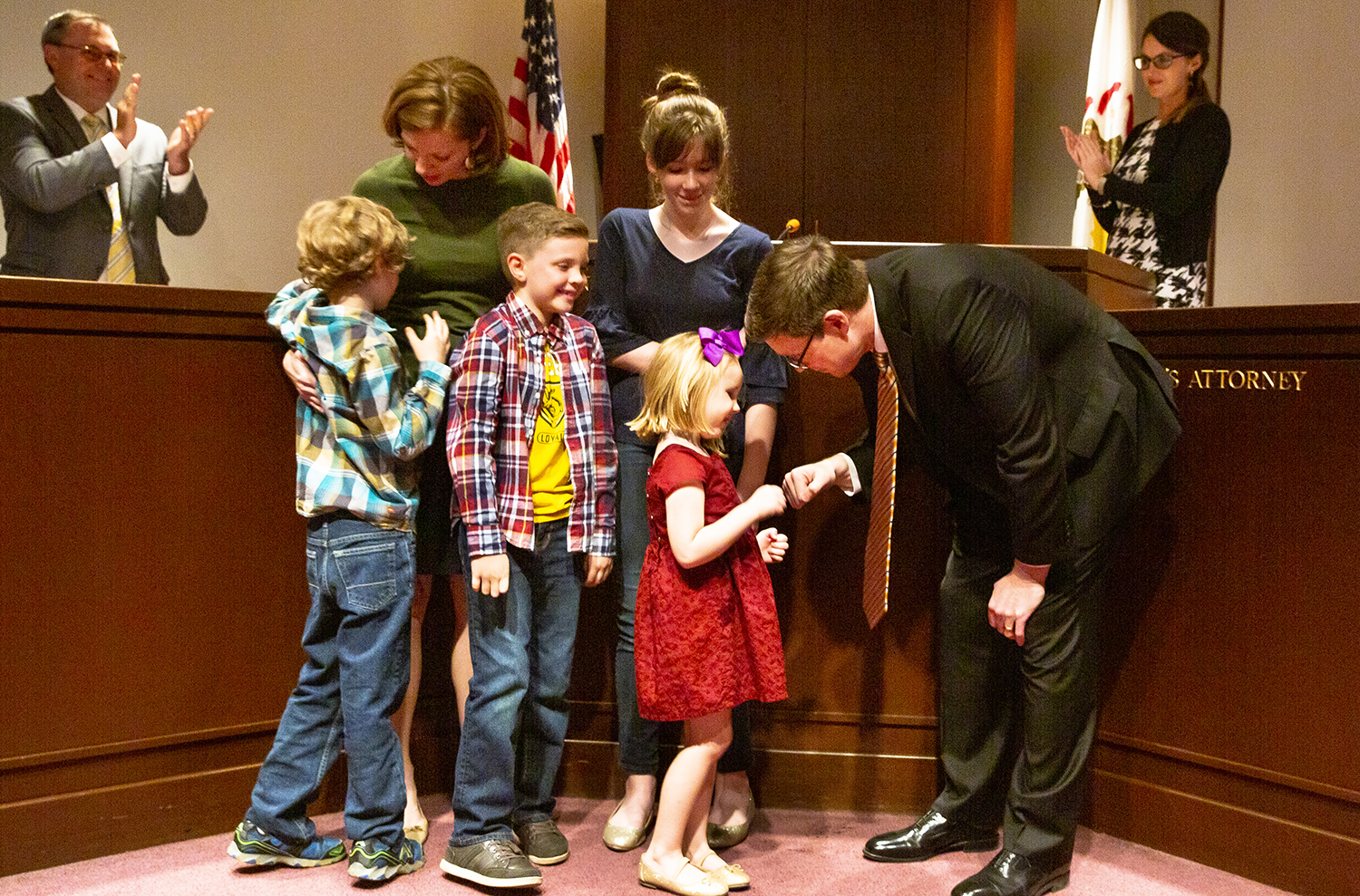 Dan Wright fist bumps his youngest daughter, Margot, 4, after he was sworn in as the new Sangamon County State's Attorney Tuesday, Oct. 30, 2018 in the Sangamon County Board Chambers in Springfield, Ill. Also with Wright are his wife, Emily, sons Henry, Jack and daughter, Anna Claire. [Rich Saal/The State Journal-Register]