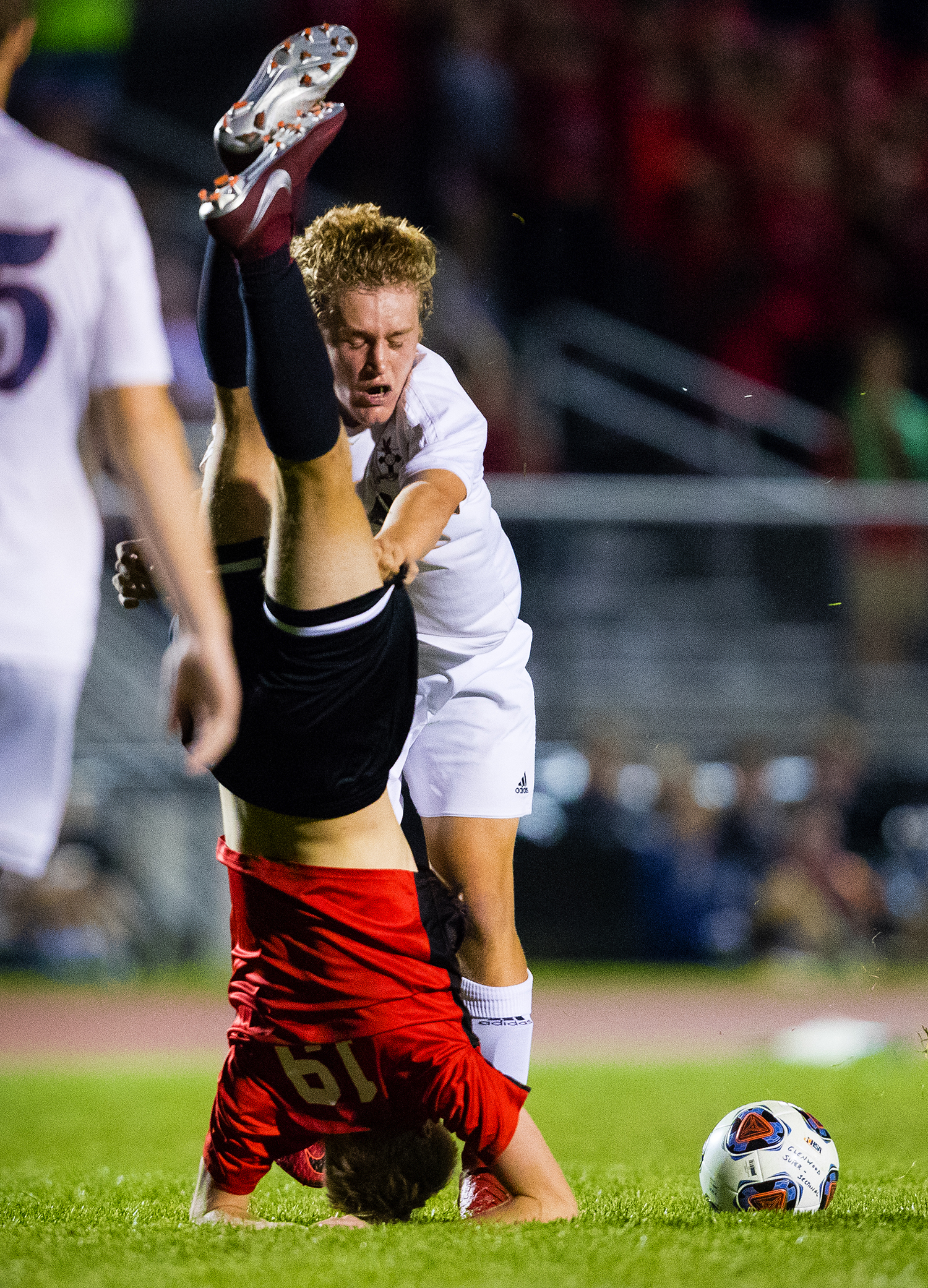 Gibault Catholic's Alex Merlenbach shoves Springfield's Wolf Brethorst over after the two got tangled up during the IHSA Class 2A Glenwood Soccer Supersectional at Glenwood High School Tuesday, Oct. 30, 2018. [Ted Schurter/The State Journal-Register]