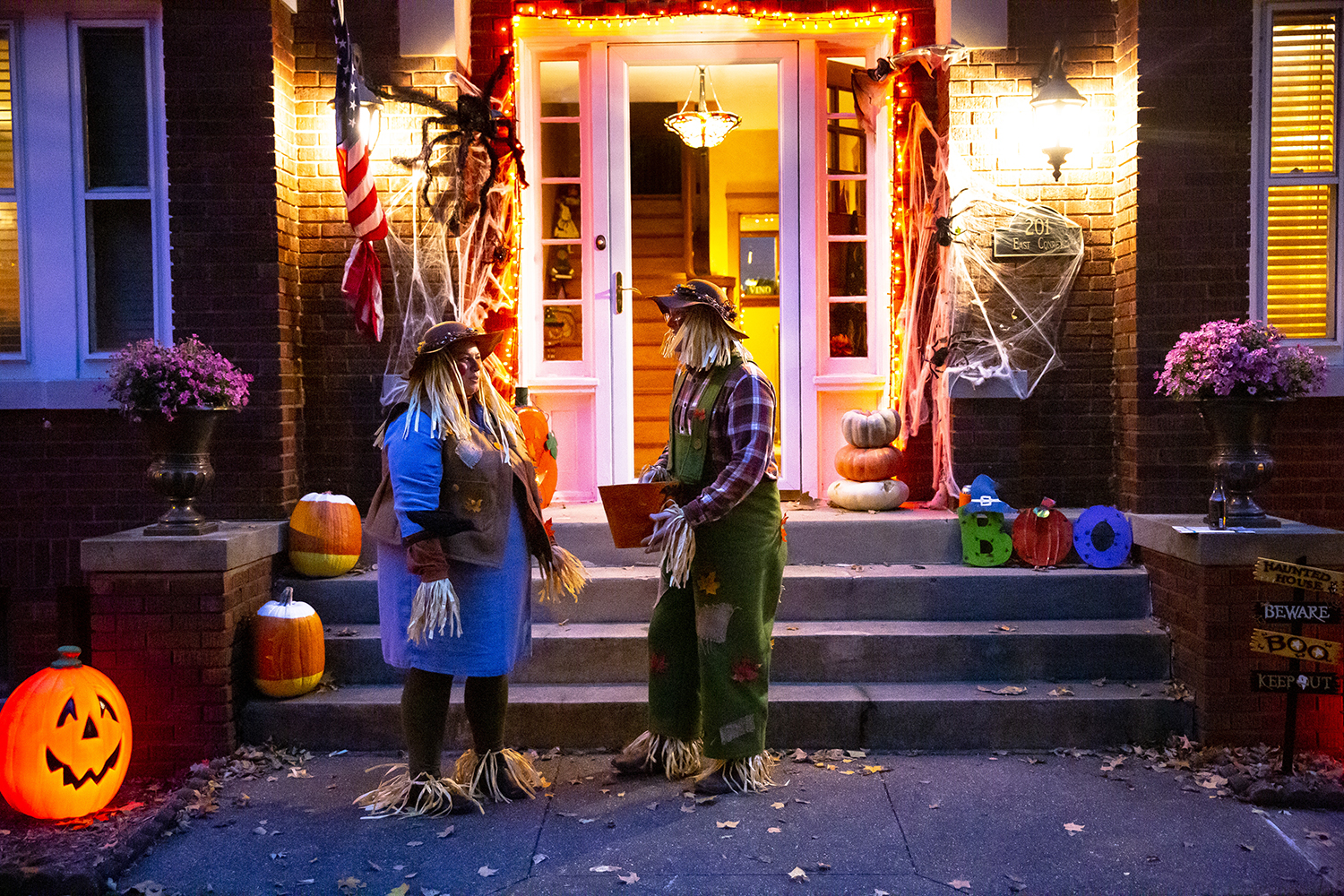 Kara and Ryan McCaffrey dressed as scarecrows to host trick or treaters at their home in Williamsville, Ill. Wednesday, Oct. 31, 2018. [Rich Saal/The State Journal-Register]