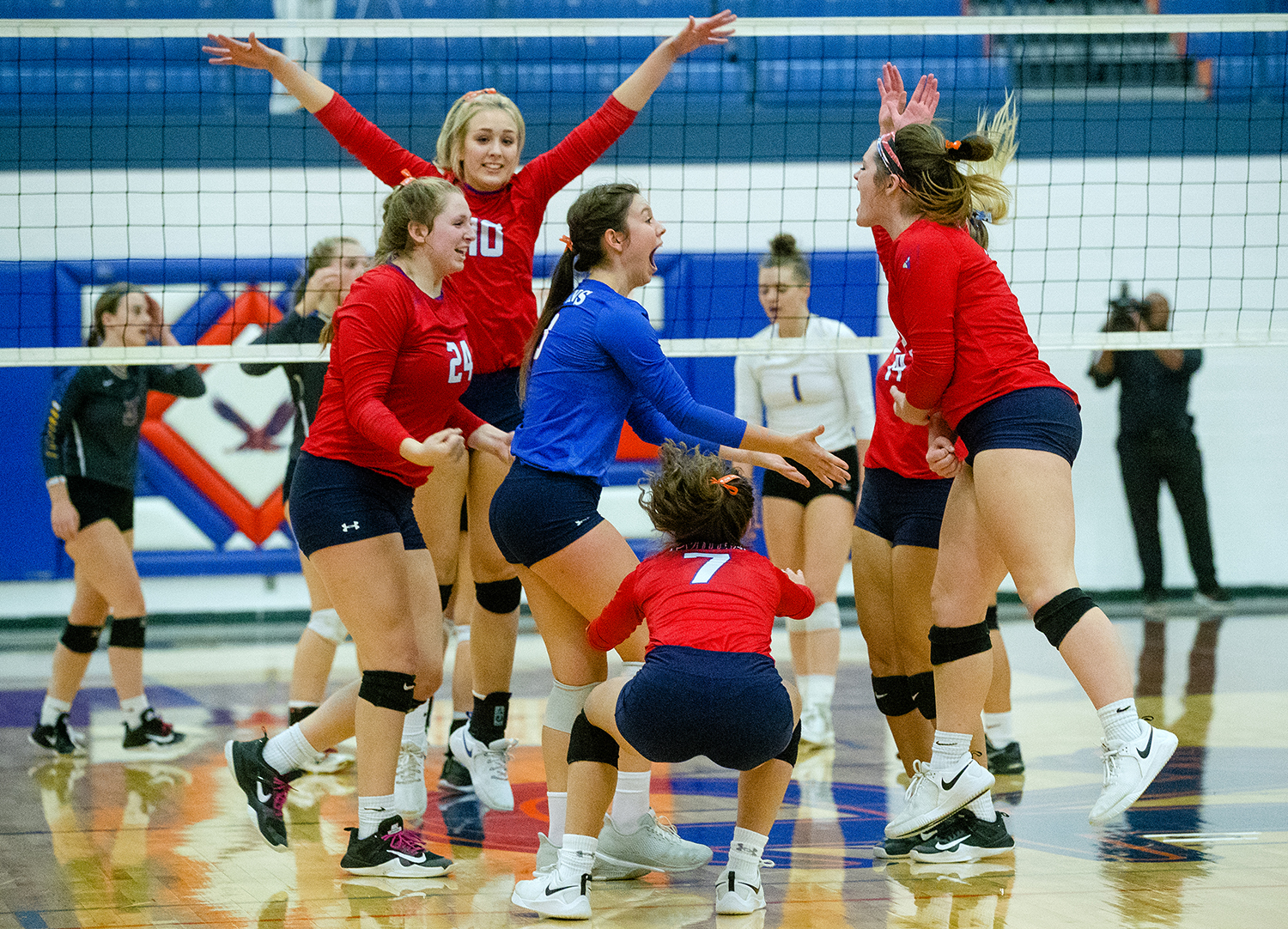 The Pleasant Plains Cardinals celebrate after defeating  Maroa-Forsyth  in two games during the IHSA Class 2A Riverton Sectional title game at Riverton High School Wednesday, October 31, 2018. [Ted Schurter/The State Journal-Register]