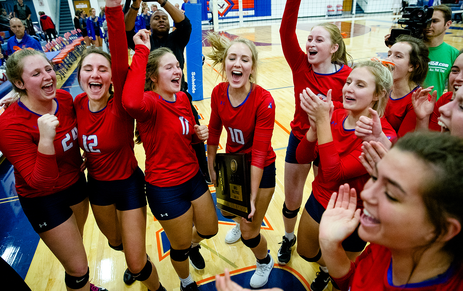 The Pleasant Plains Cardinals celebrate with their sectional championship plaque after defeating Maroa-Forsyth in two games during the IHSA Class 2A Riverton Sectional title game at Riverton High School Wednesday, October 31, 2018. [Ted Schurter/The State Journal-Register]